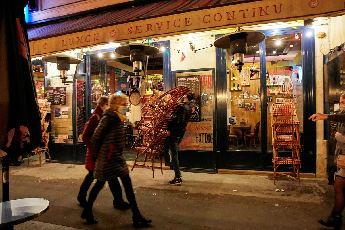 Restaurants and cafés close before curfew in Paris, which started at 9 p.m. on October 17.