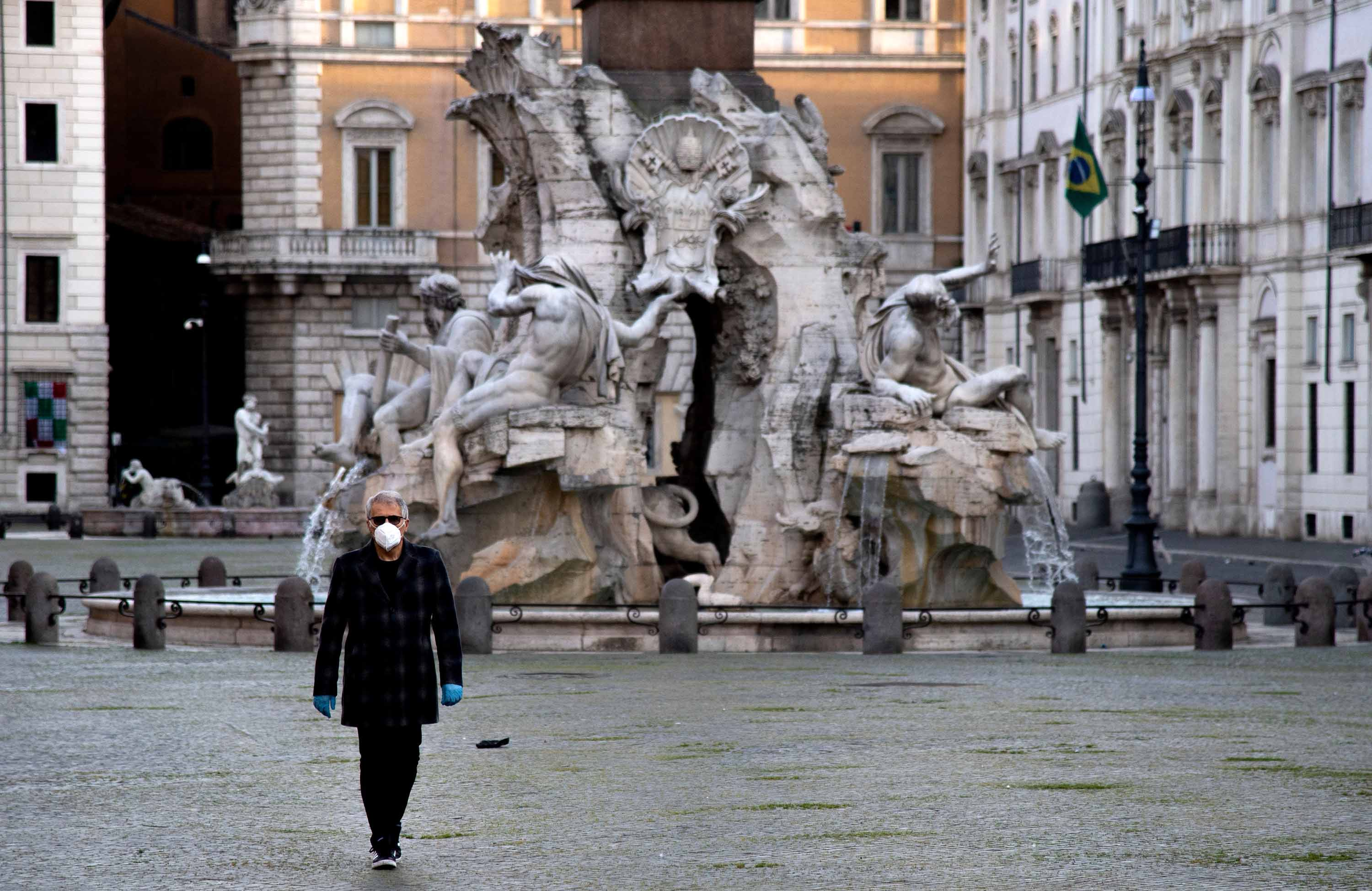 A man walks in Piazza Navona in Rome on April 16.