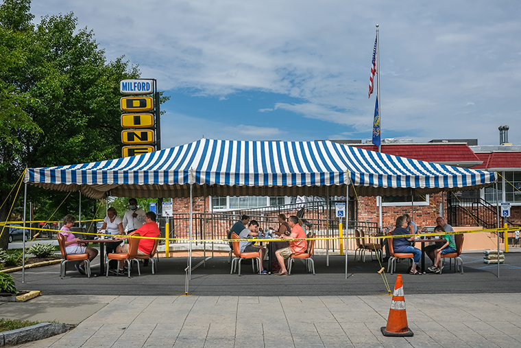 People are seen drinking and eating at a restaurant in Milford, Pennsylvania, on May 6.