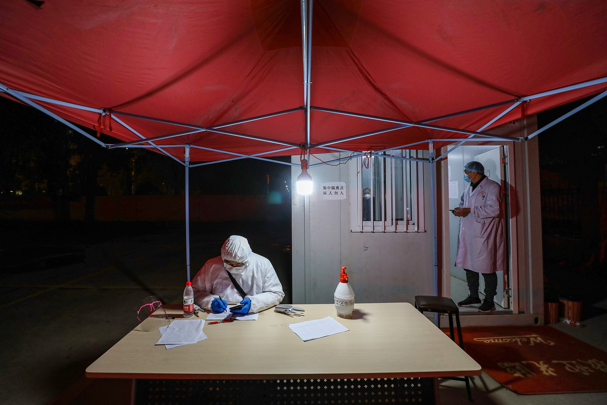 Medical staff members work at a quarantine zone in Wuhan on February 3.