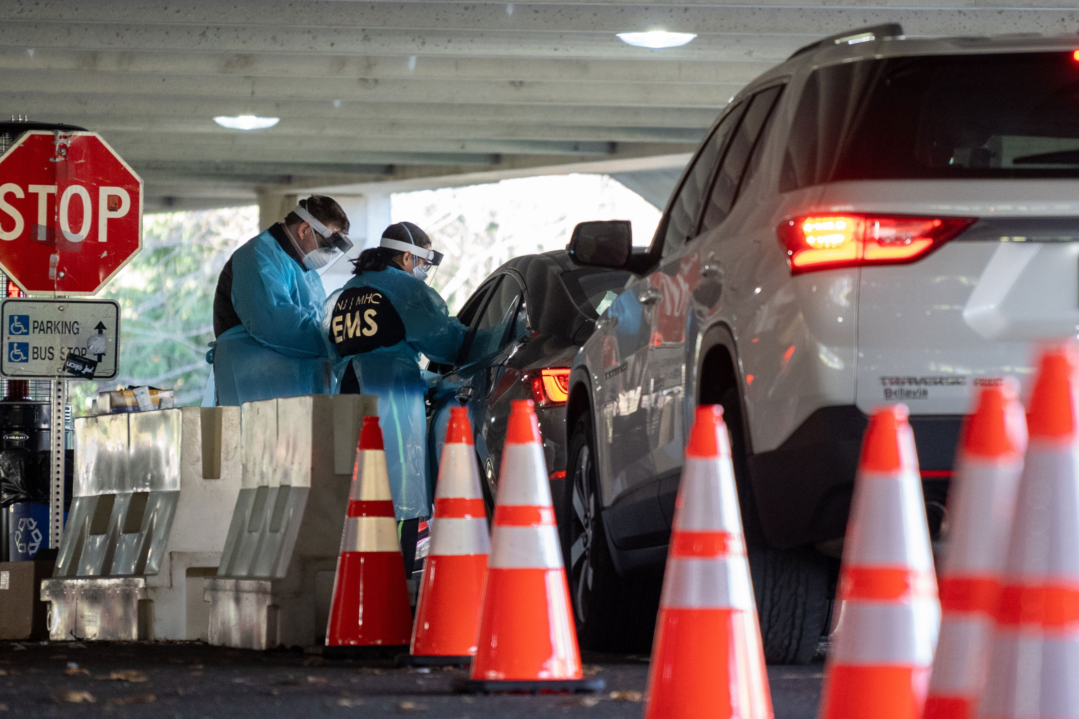 People line up in cars at a Covid-19 testing site in Paramus, New Jersey, on December 3.