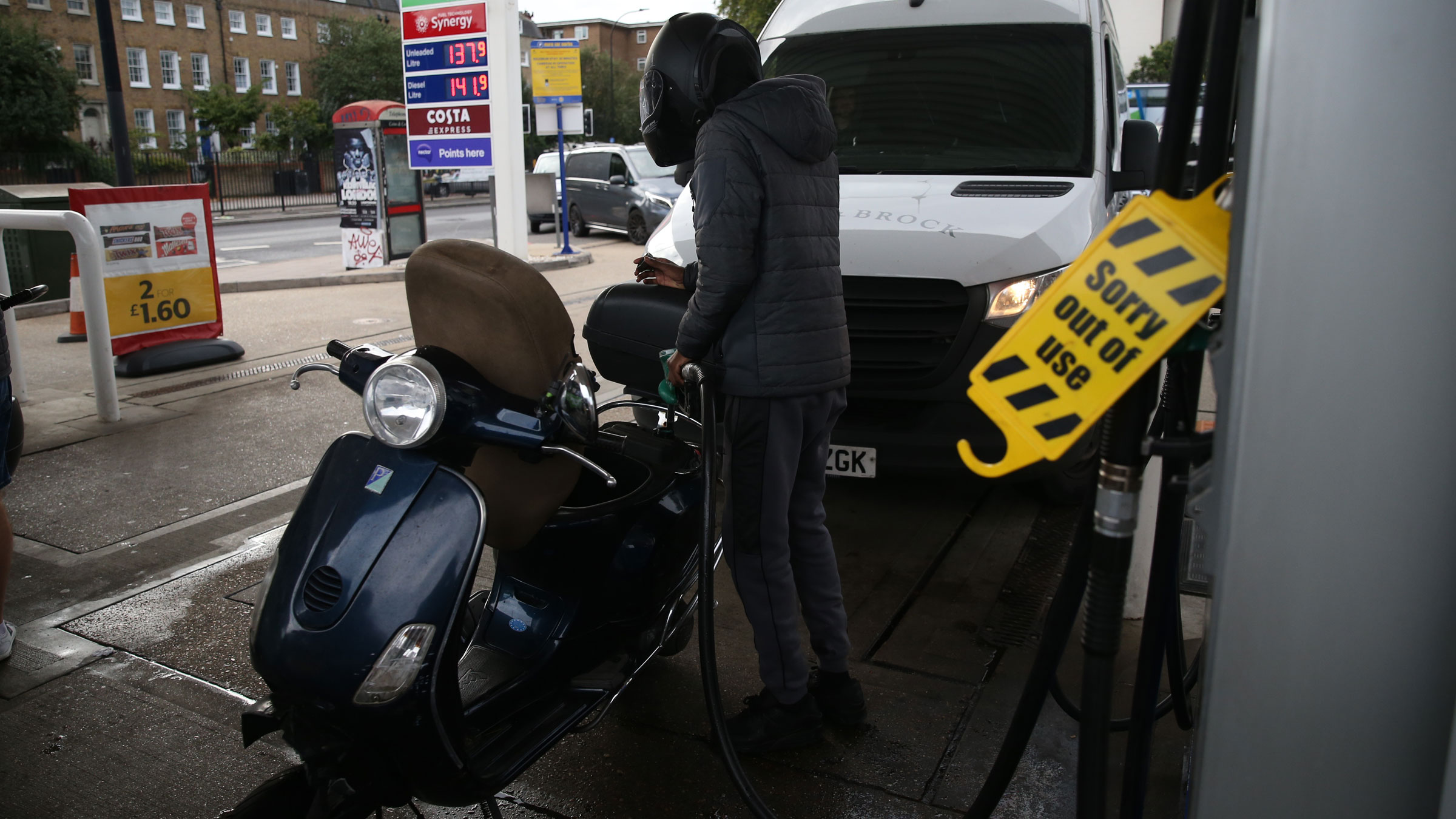 A motorist fills up a vehicle at a London gas station on Tuesday.
