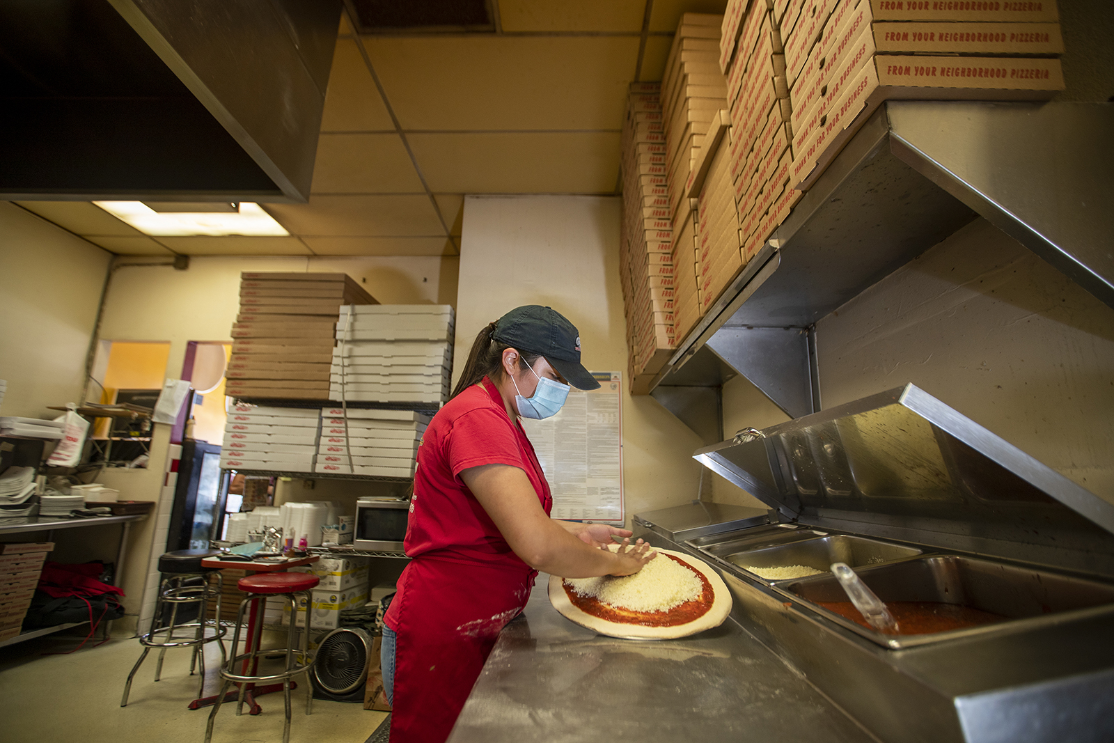 Jocelyn Campos, 28, manager of Big Berthas Pizza, makes pizza at her family's restaurant near Disneyland on Wednesday, September 30, in Anaheim, California.