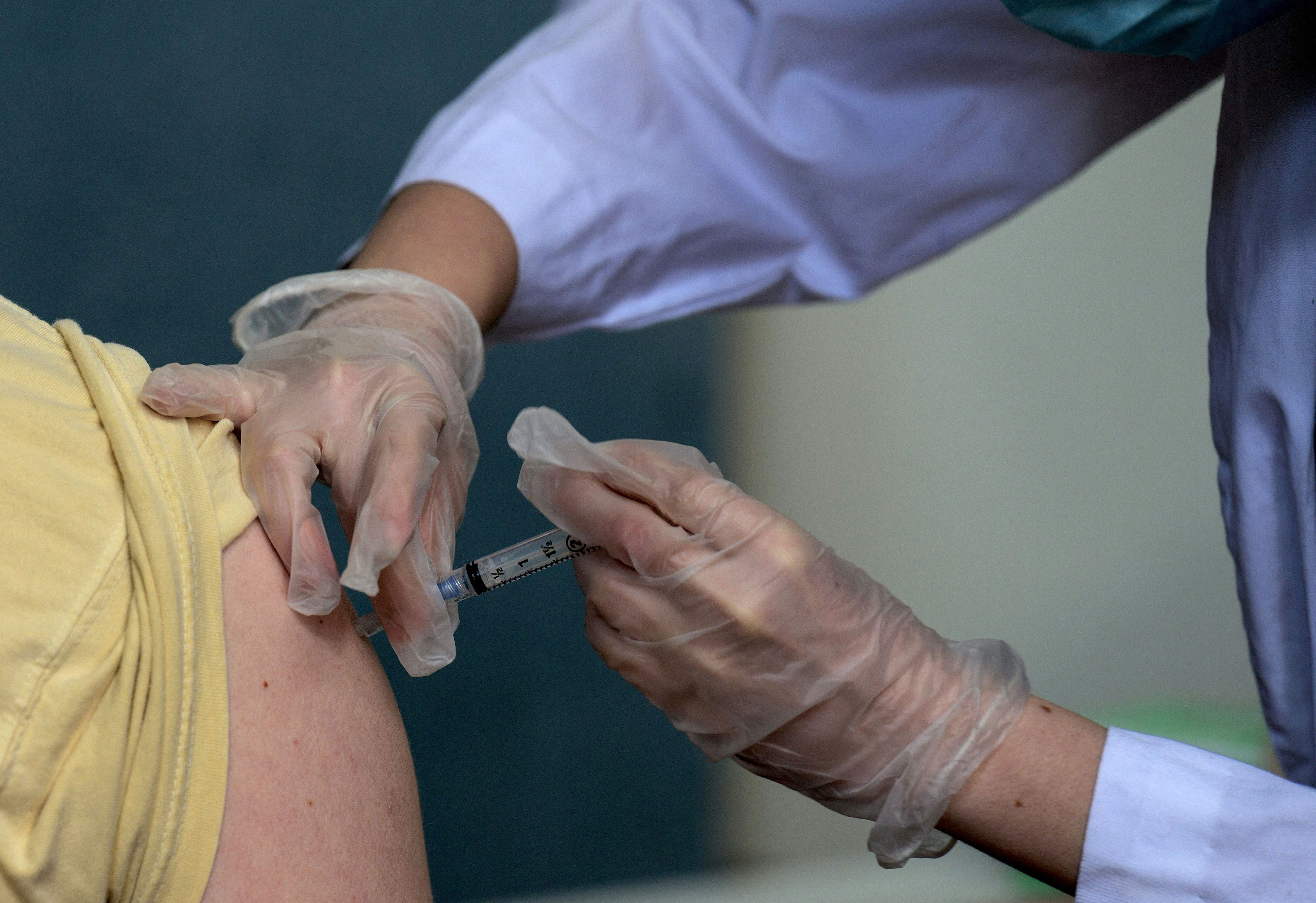 A medical staff member administers a dose of the ModernaCovid-19 vaccine on April 16 in Staten Island, New York.
