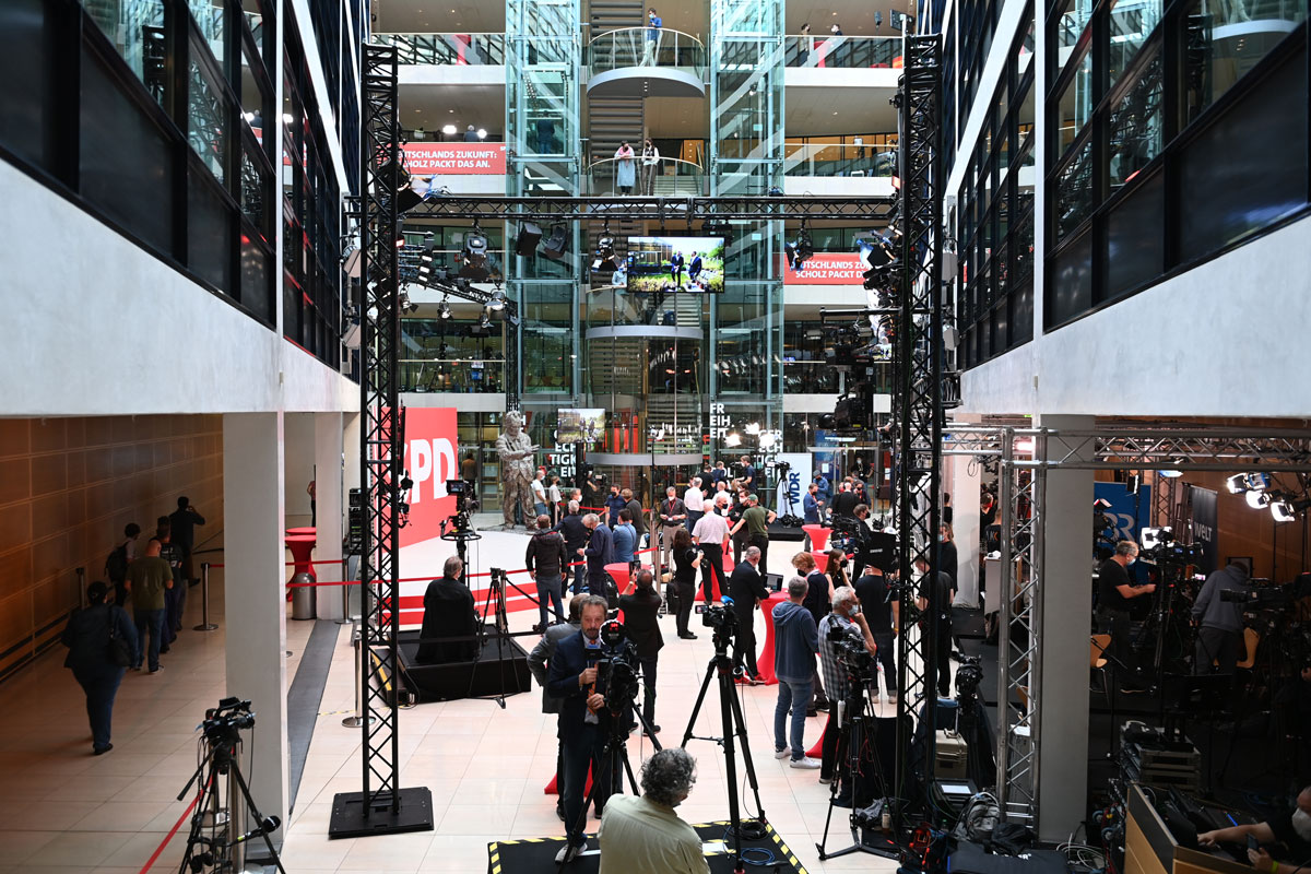 Members of the media start to gather at the SPD party headquarters in Berlin.