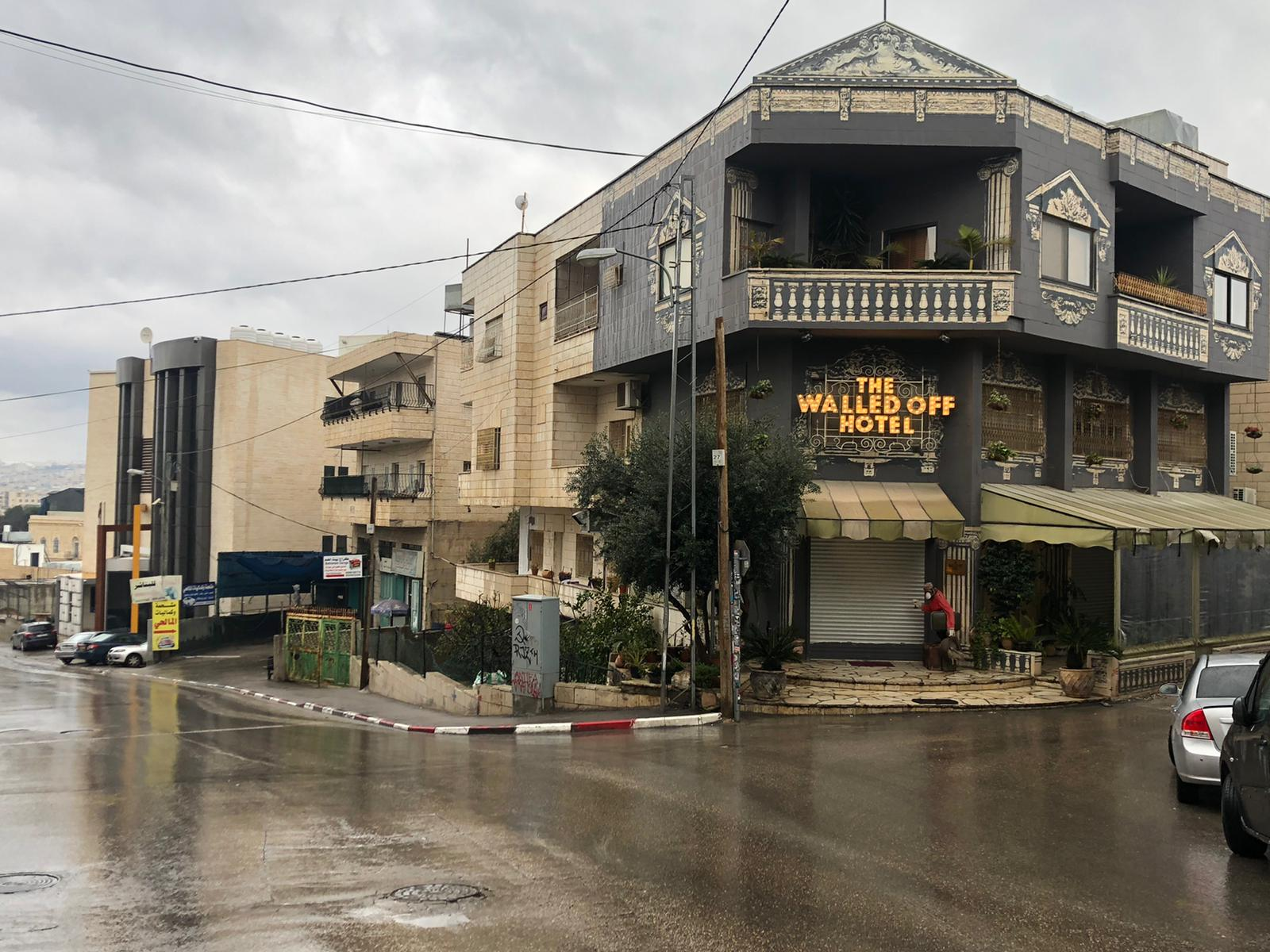 """The streets of Bethlehem are deserted and the shutters are down at """"The Walled Off Hotel,"""" which lies in the shadow of the wall erected by Israel to separate it from the Palestinian territories."""