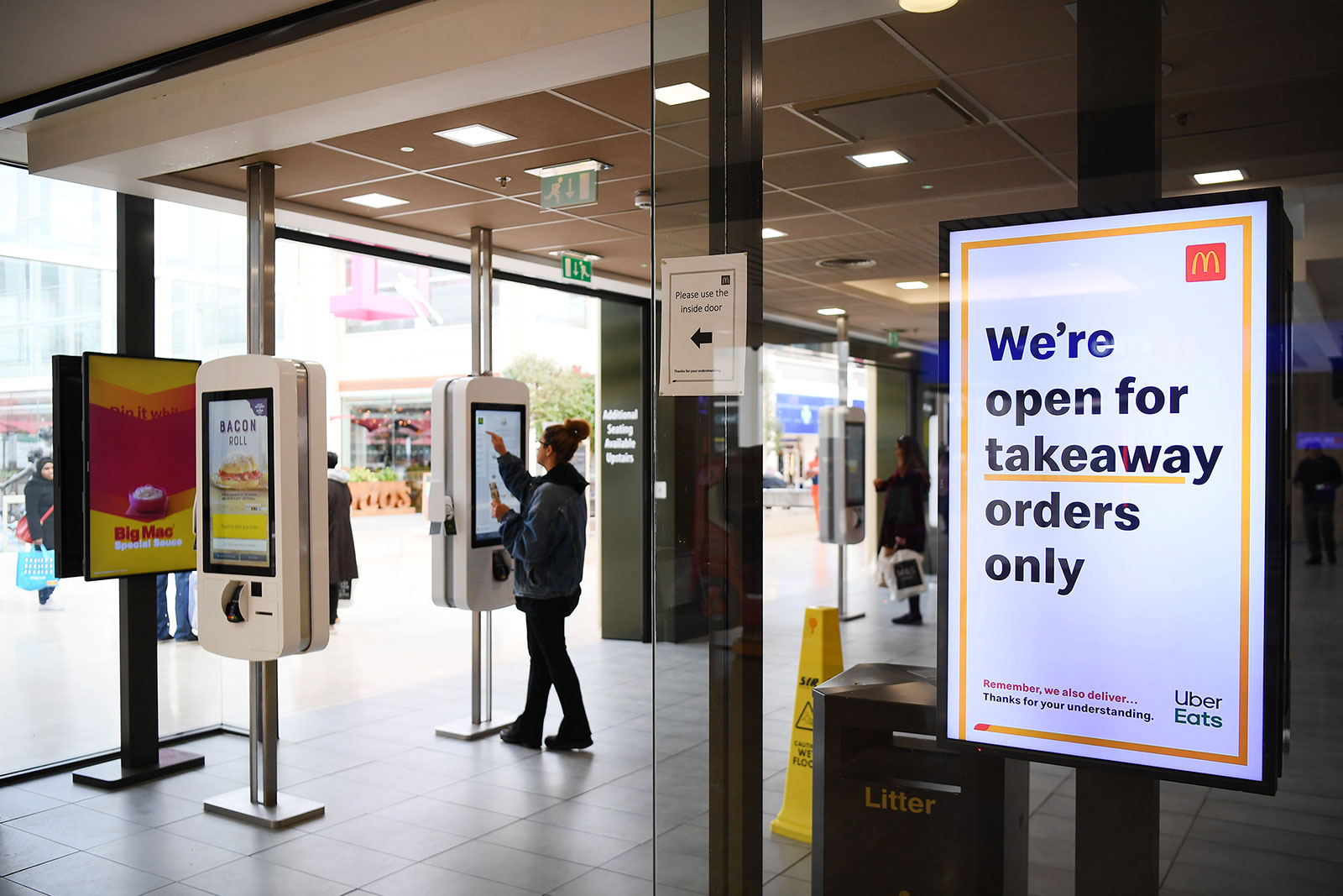 A customer orders from a self-service kiosk at a McDonald's in Milton Keynes, England, on March 20.