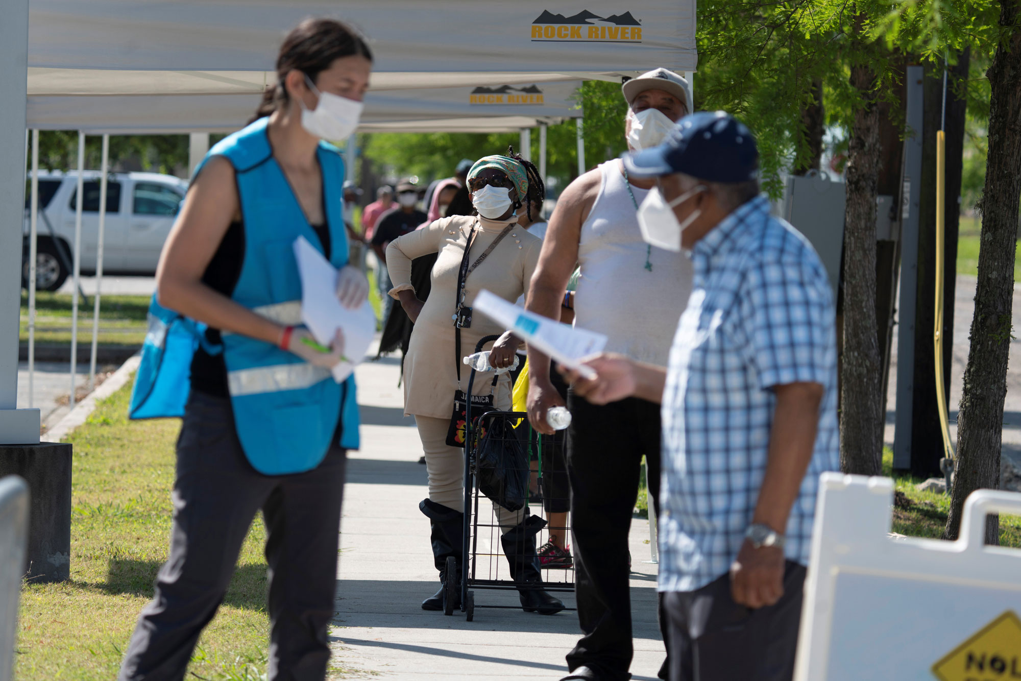People line up for walk-up coronavirus disease testing at Xavier University of Louisiana in New Orleans, on April 21.