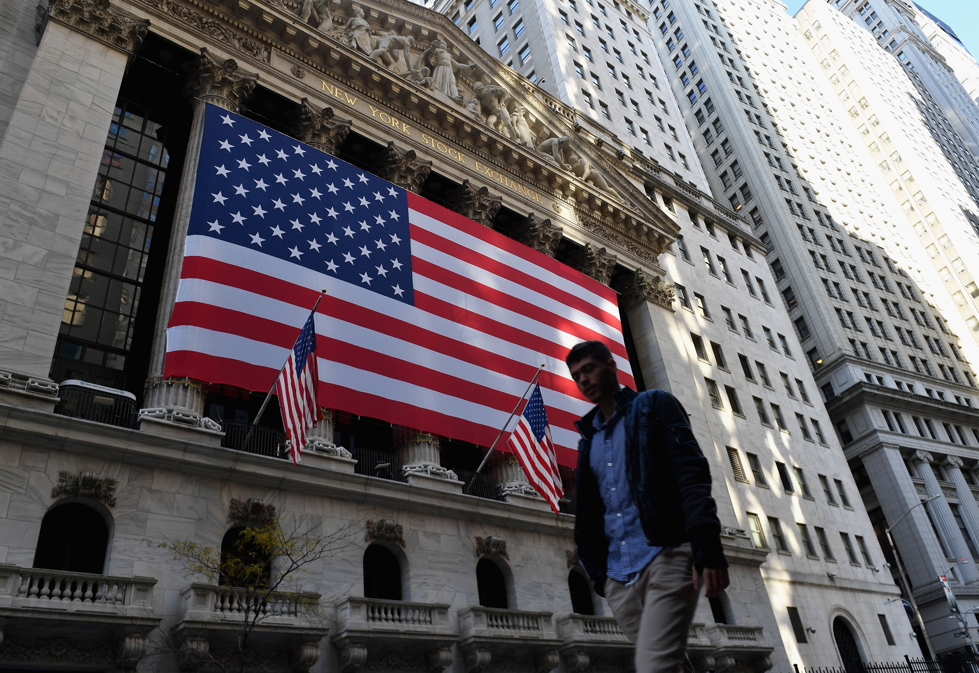A person walks past the New York Stock Exchange on November 16 in New York City.