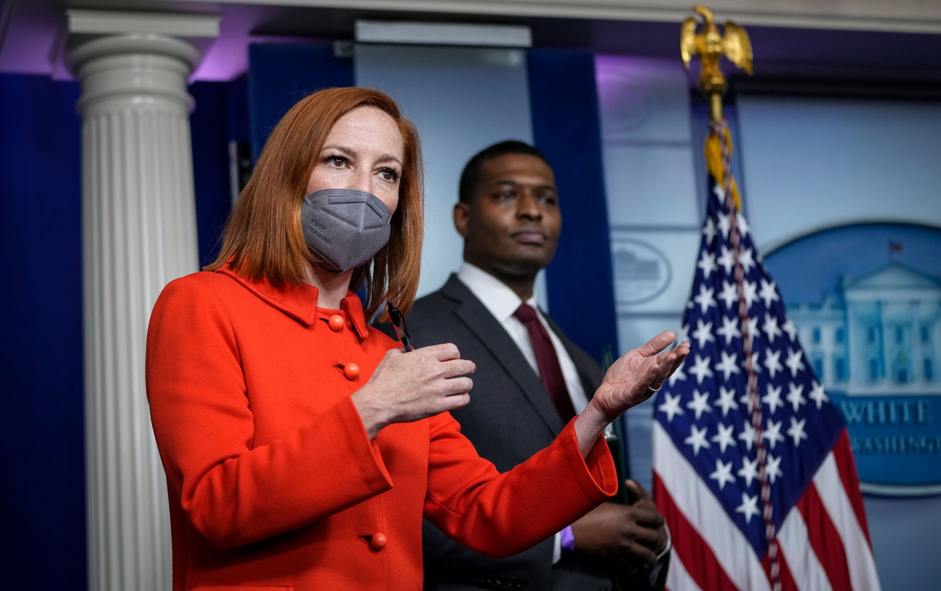 White House Press Secretary Jen Psaki speaks as Administrator of the Environmental Protection Agency Michael Regan looks on during the daily press briefing at the White House on May 12 in Washington, DC.