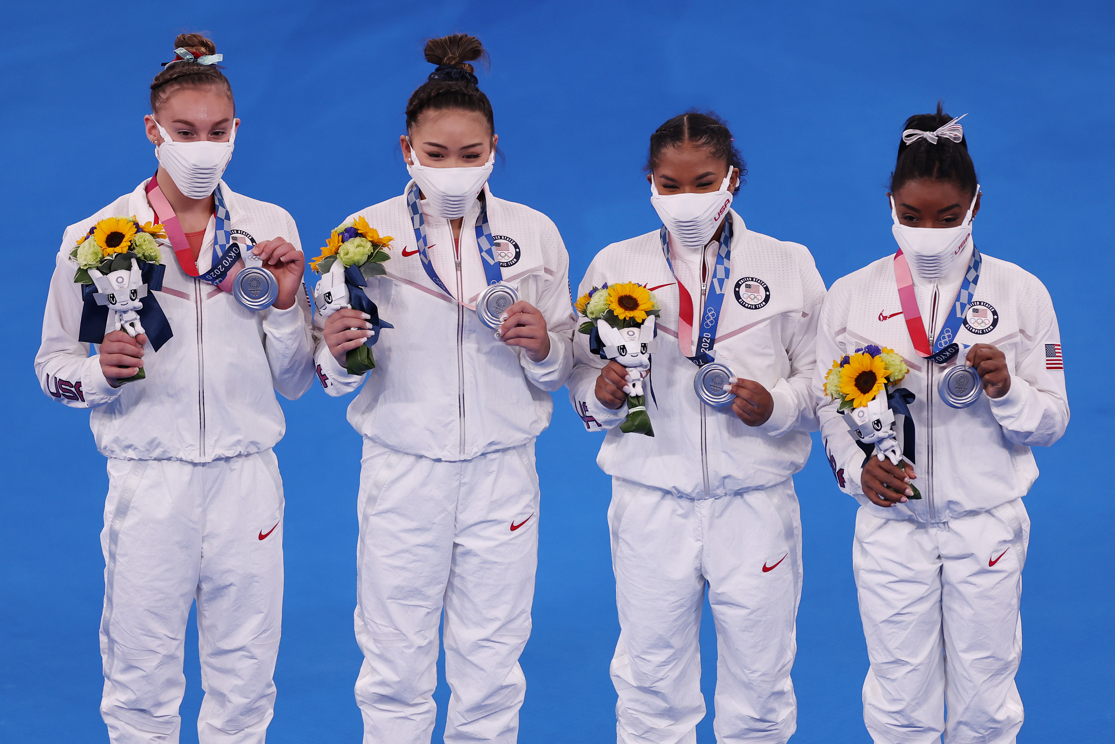 From left, American gymnasts Grace McCallum, Sunisa Lee, Jordan Chiles and Simone Biles celebrate after winning the silver medal during the Women's Team Final on July 27.