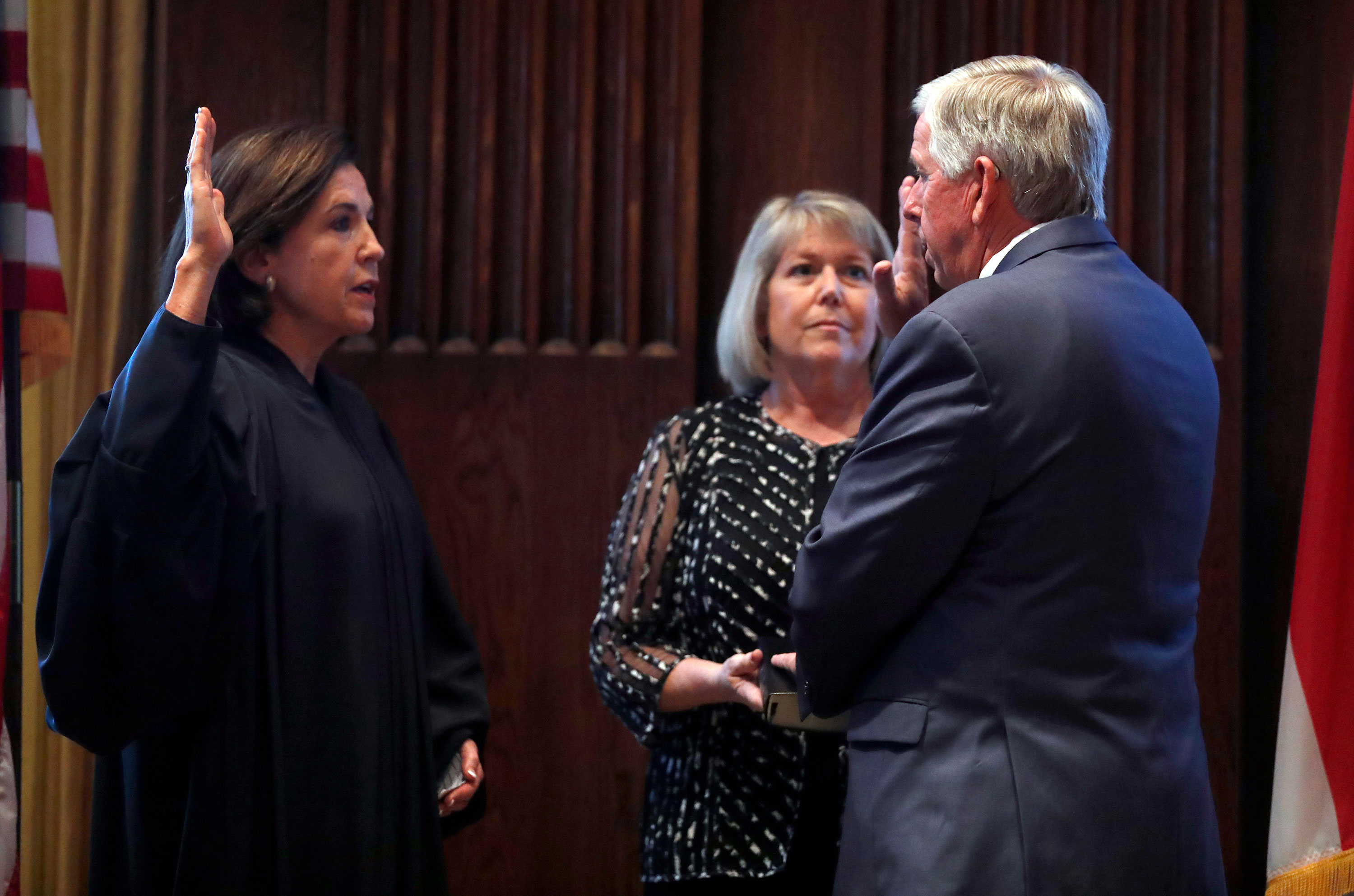 Teresa Parson watches as her husband Mike Parson is sworn in as the state's 57th governor by Judge Mary Rhodes Russellin June 2018.