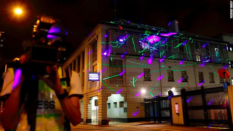 Laser beams shone by protesters to light up the Shum Shui Po police station in Hong Kong on Wednesday.