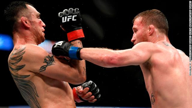 Justin Gaethje, right, punches Tony Ferguson in their interim lightweight title fight during UFC 249 at VyStar Veterans Memorial Arena on Saturday in Jacksonville, Florida.