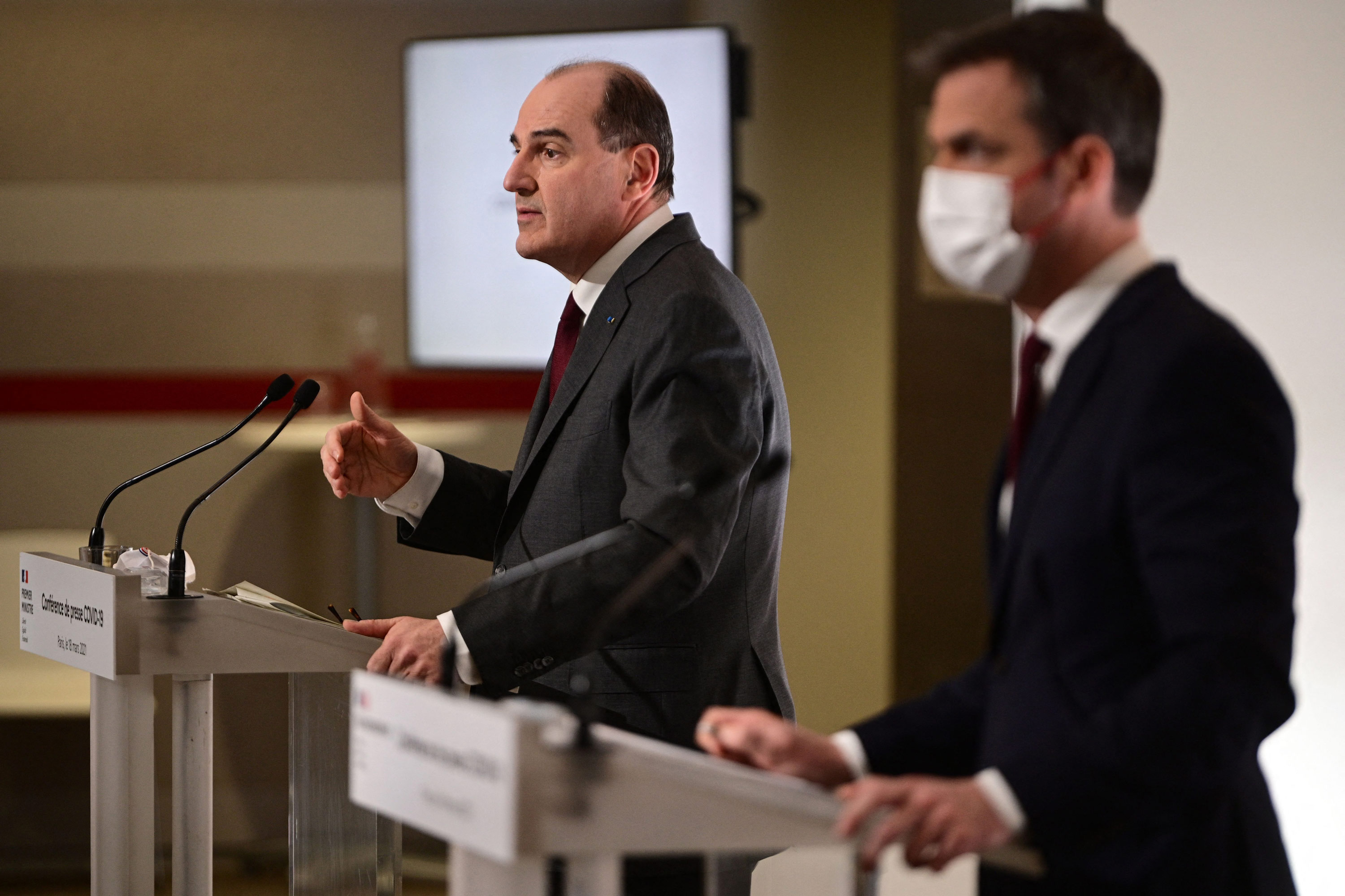 French Prime Minister Jean Castex, left, and French Health Minister Olivier Veran deliver a joint press conference in Paris on March 18.