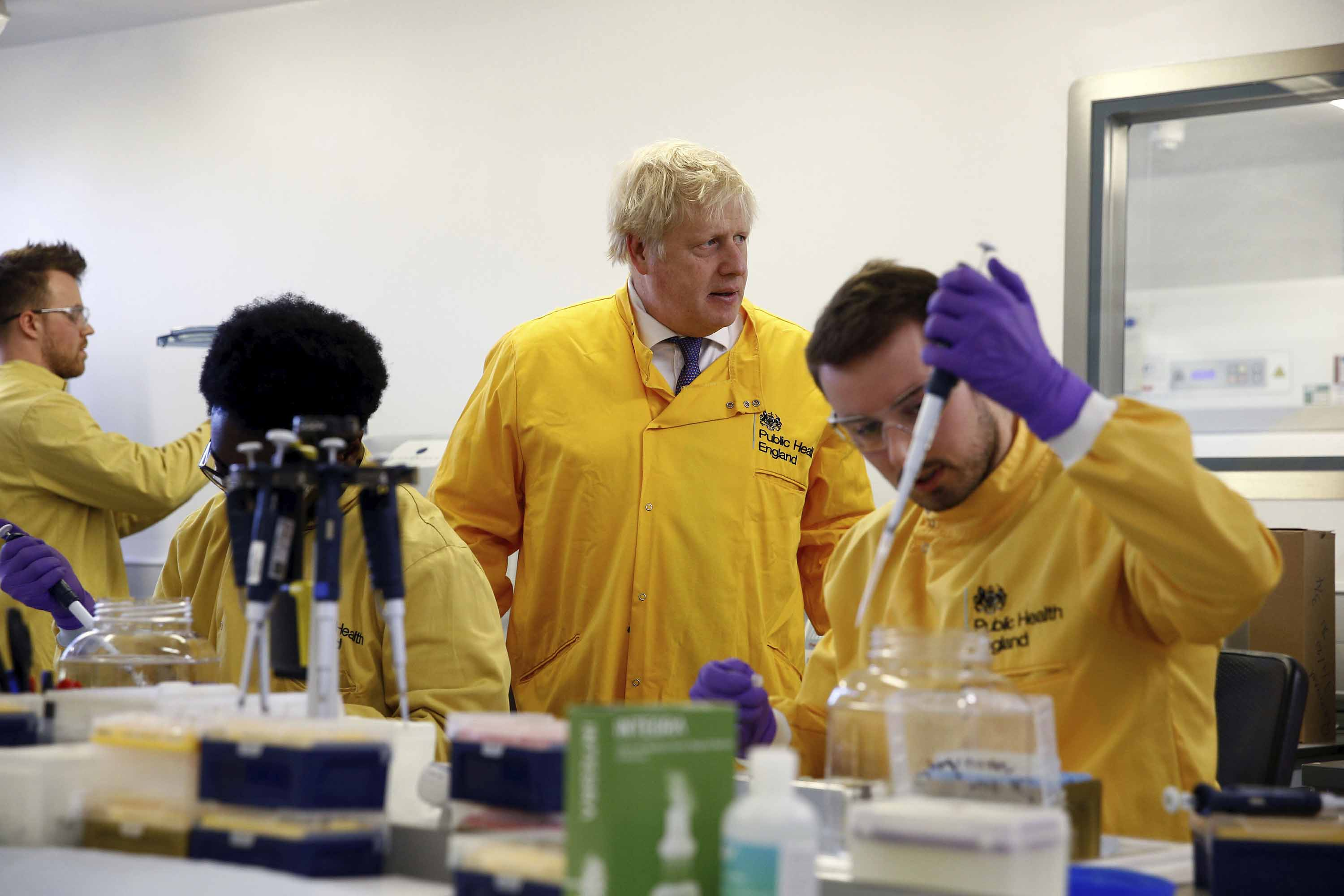 Prime Minister Boris Johnson visits a laboratoryat the Public Health England National Infection Service in north London, after more coronavirus patients were identified in the country on Sunday.