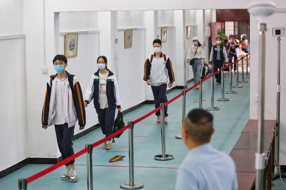 Students arrive at a high school in Wuhan in China's central Hubei province on May 6.