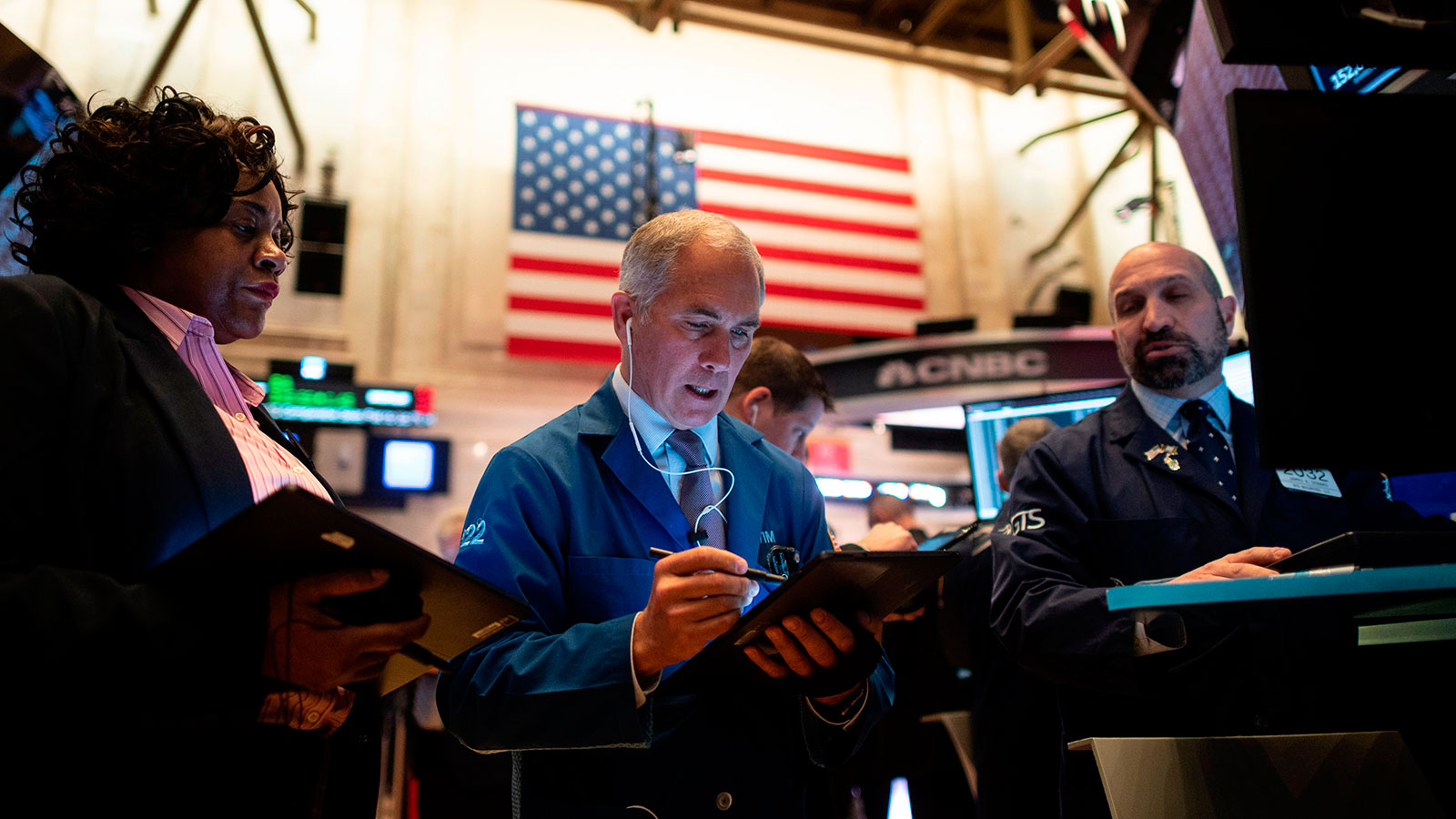 Traders work during the opening bell at the New York Stock Exchange at Wall Street in New York City.