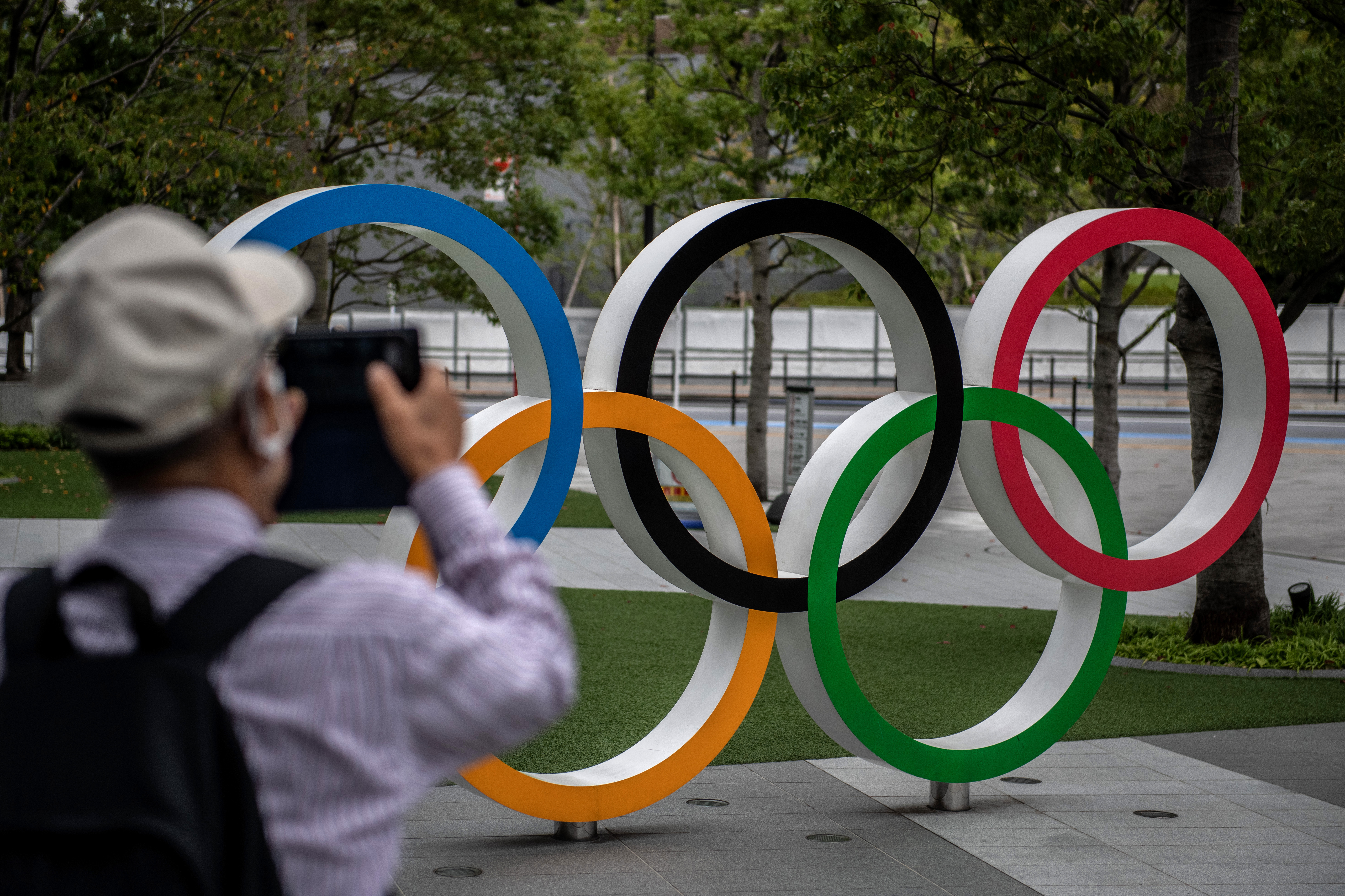 A man photographs the Olympic Rings in Tokyo, Japan on October 13.