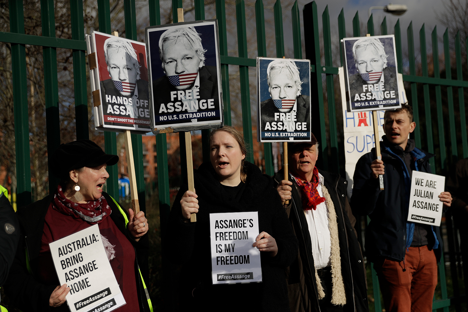 Supporters of Assange hold placards outside Belmarsh Magistrates' Court in southeast London in late February.