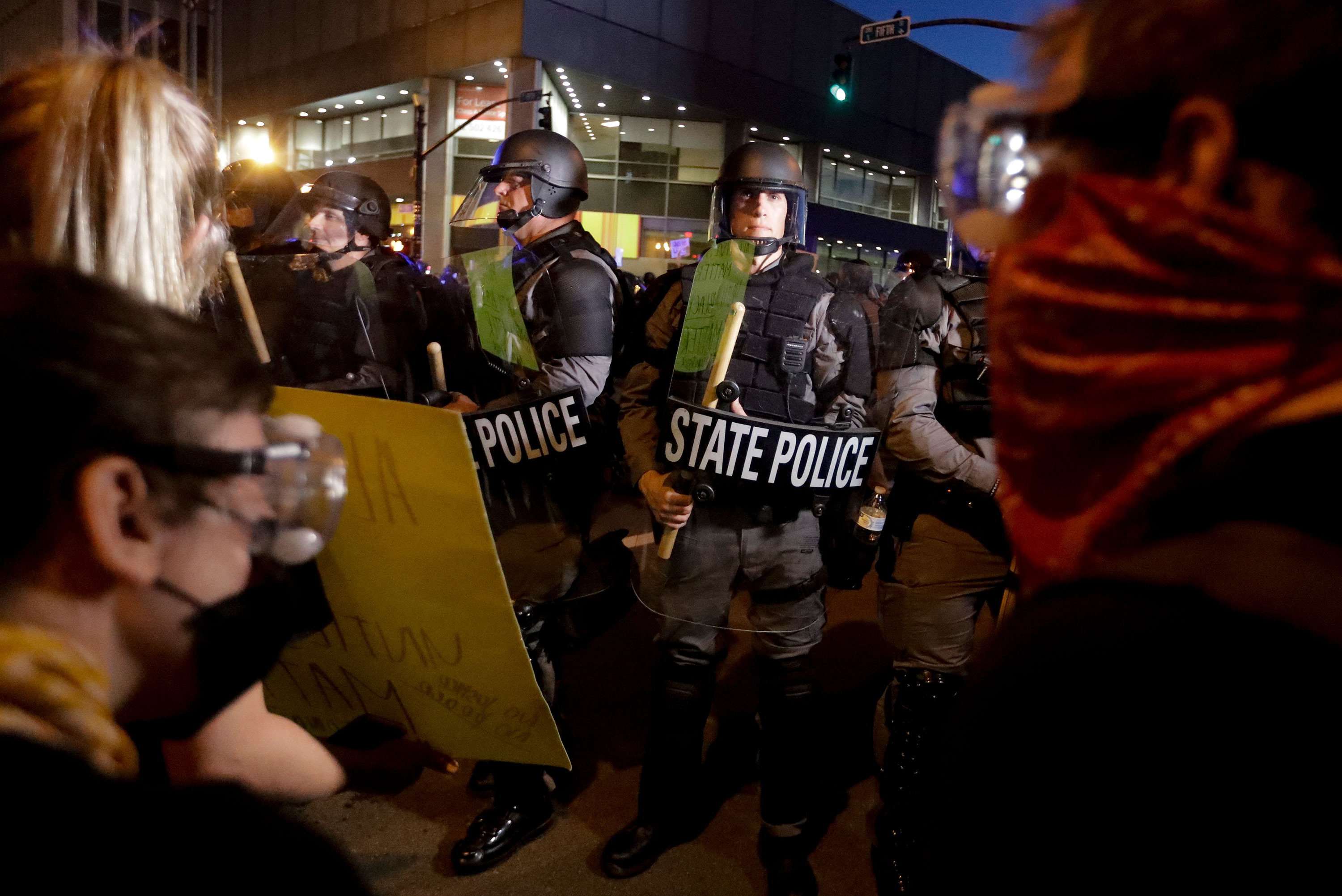 Protesters stand in front of Kentucky State Police officers in Louisville, Kentucky, on May 29.