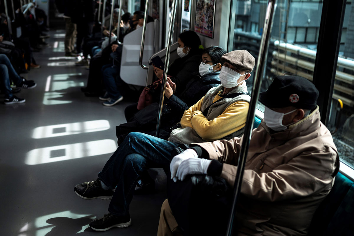 People commute on a train in Tokyo, Japan on March 5 as officials extended a coronavirus state of emergency in the Tokyo area.