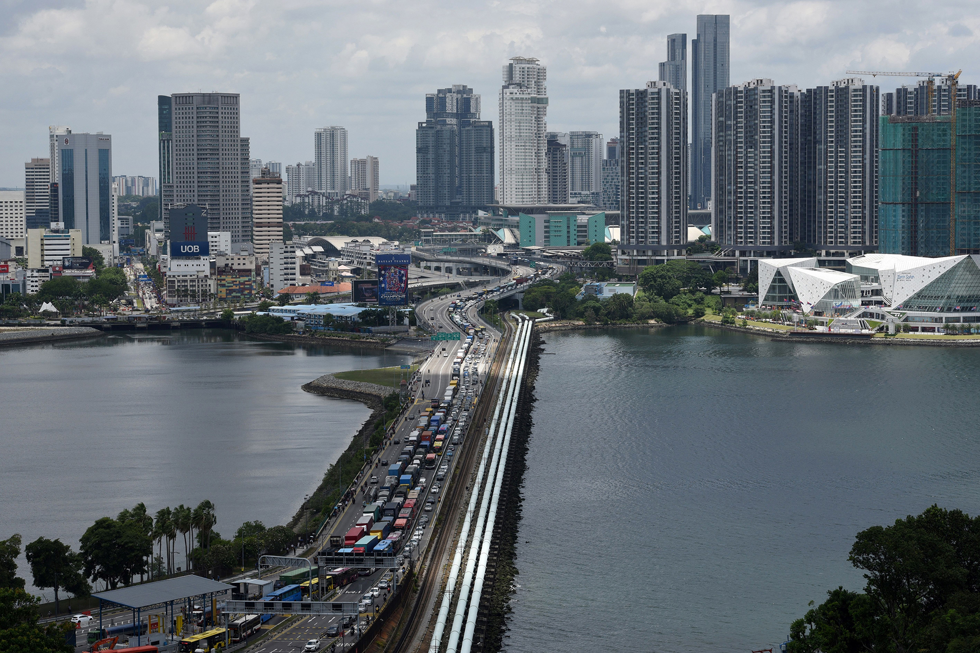 Vehicles form a long queue to enter Woodlands checkpoint in Singapore on March 17.