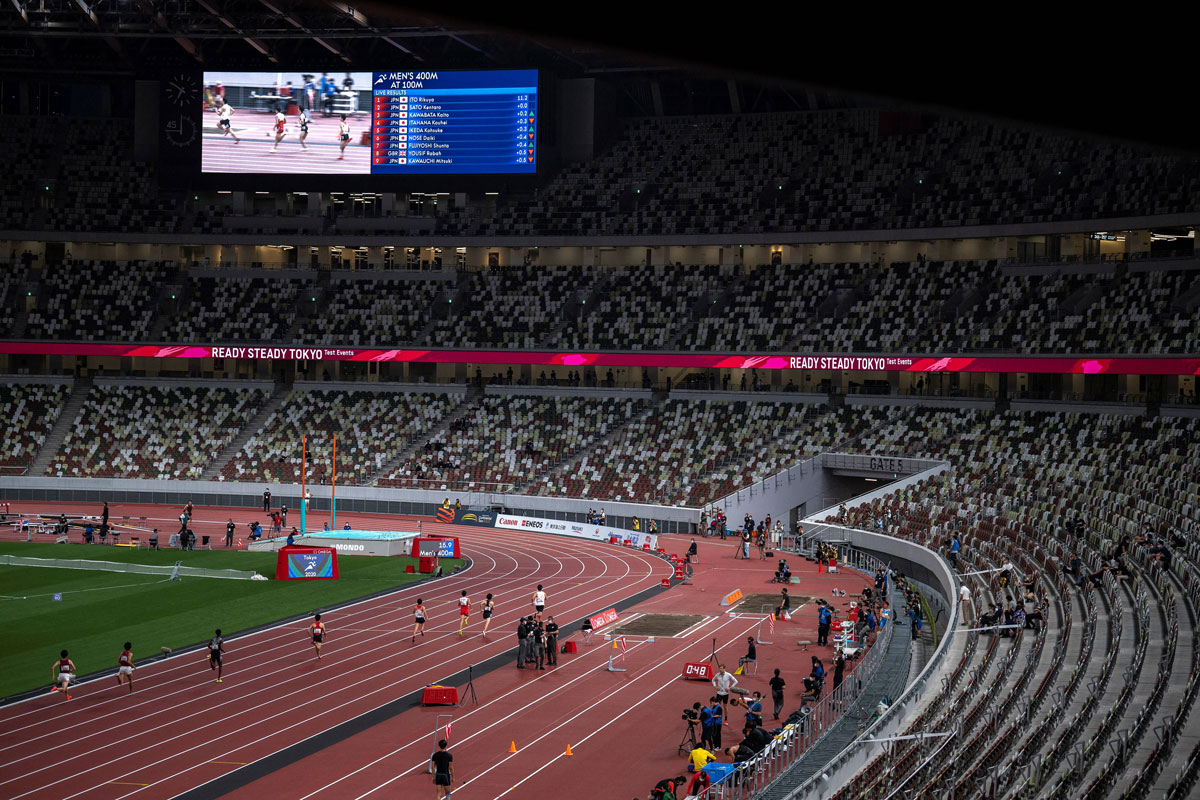 Athletes compete in the 400m race test event for the 2020 Tokyo Olympics at the National Stadium in Tokyo, Japan on May 9.