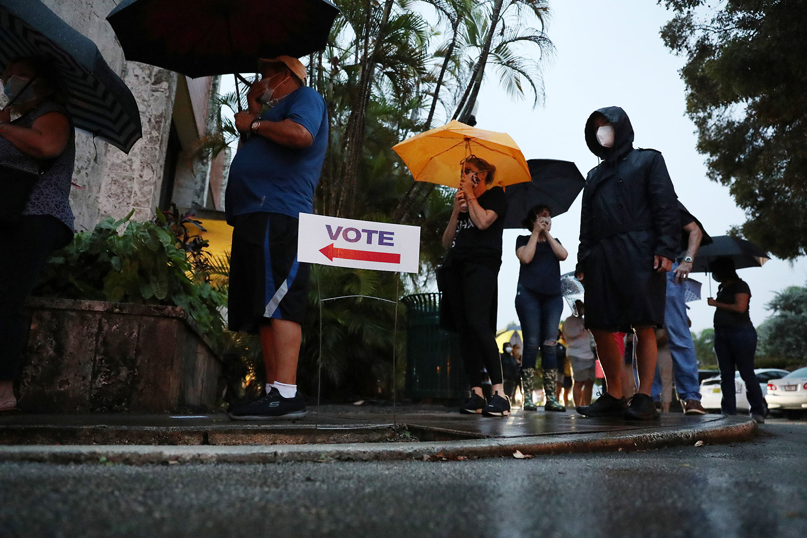 People wait in line to vote in Coral Gables, Florida, on Monday, October 19.