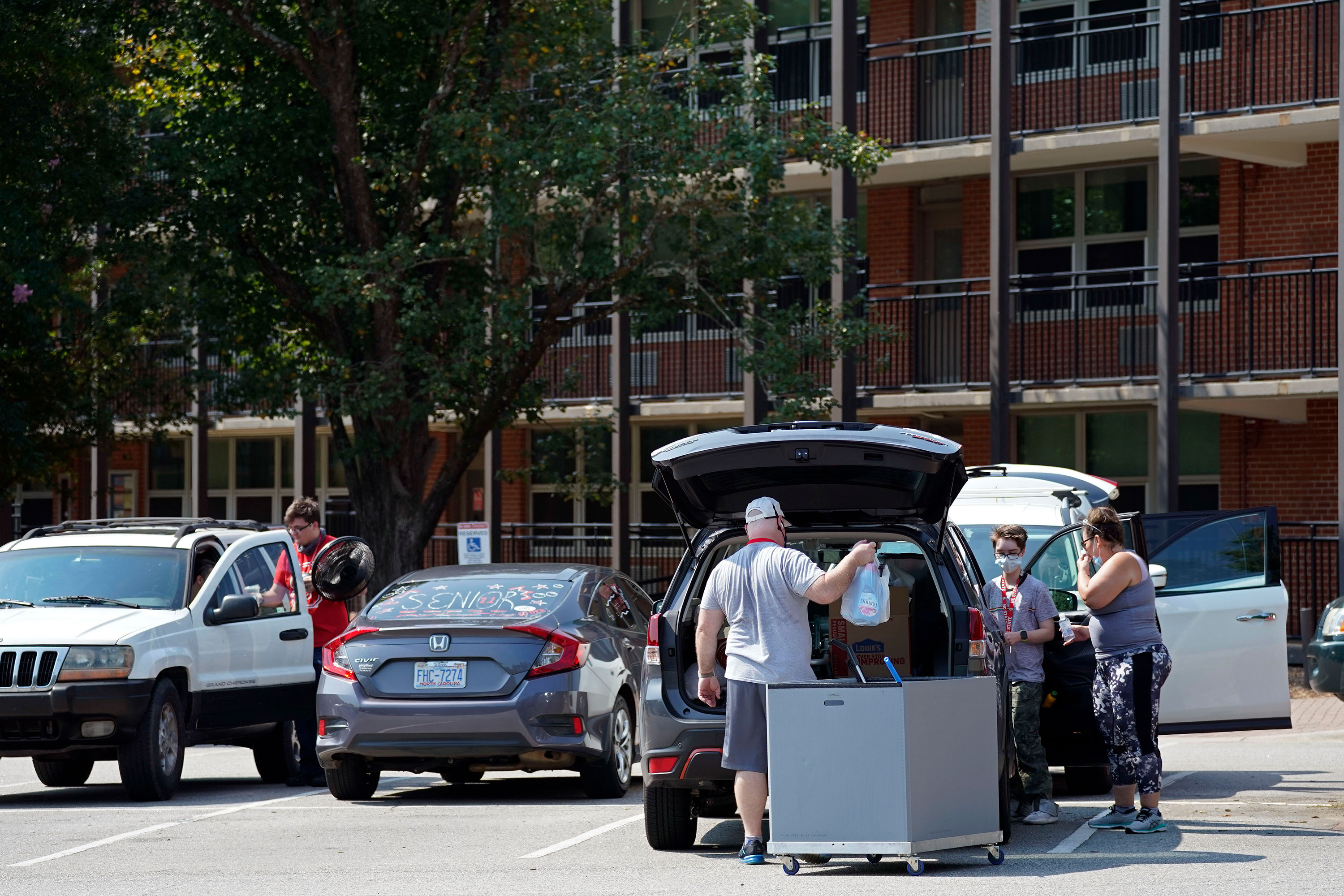 Students and parents begin to move belongings out of Bragaw Hall at North Carolina State University in Raleigh, North Carolina, on August 27.