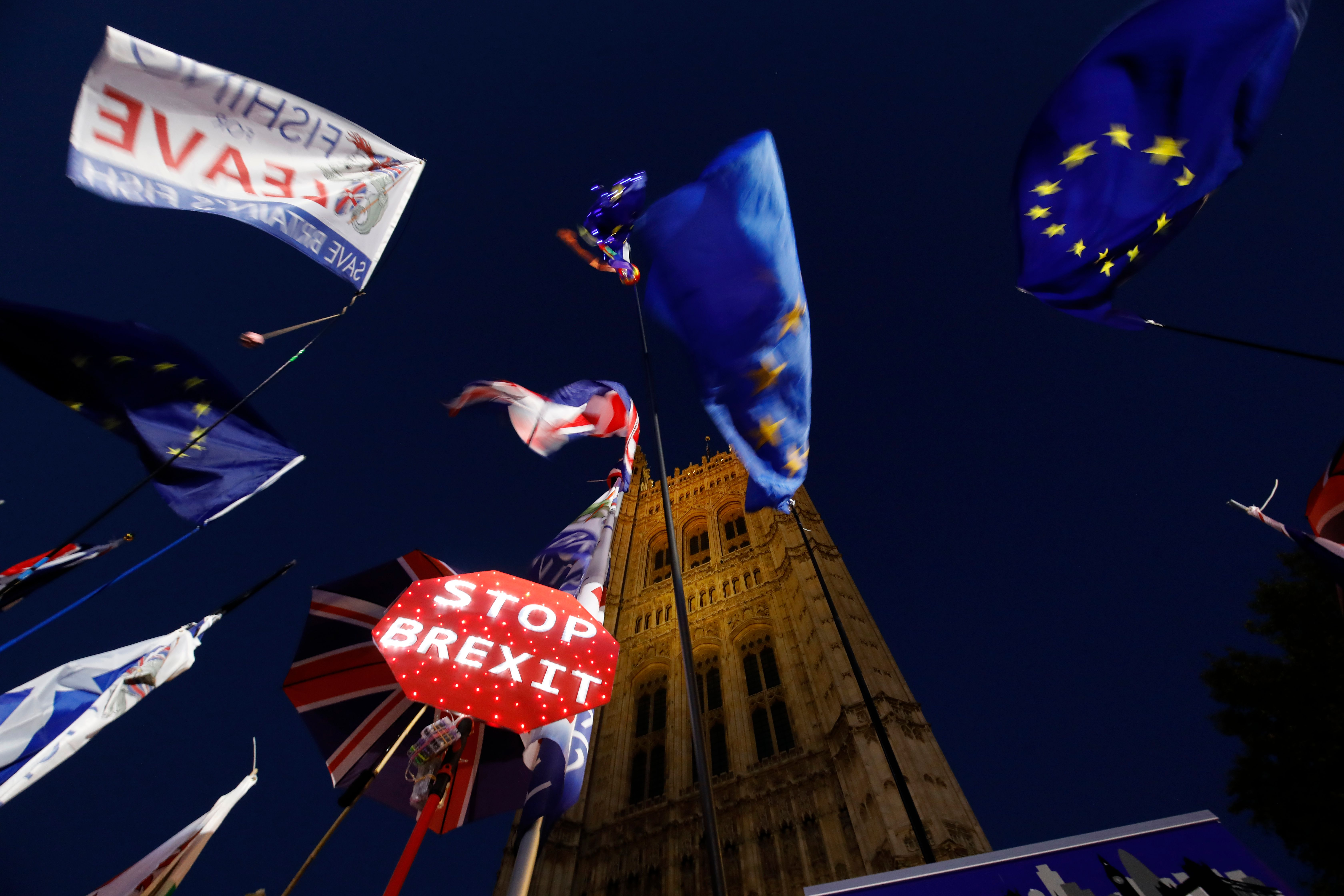 Banners, Union and EU flags are displayed outside the Houses of Parliament in London.