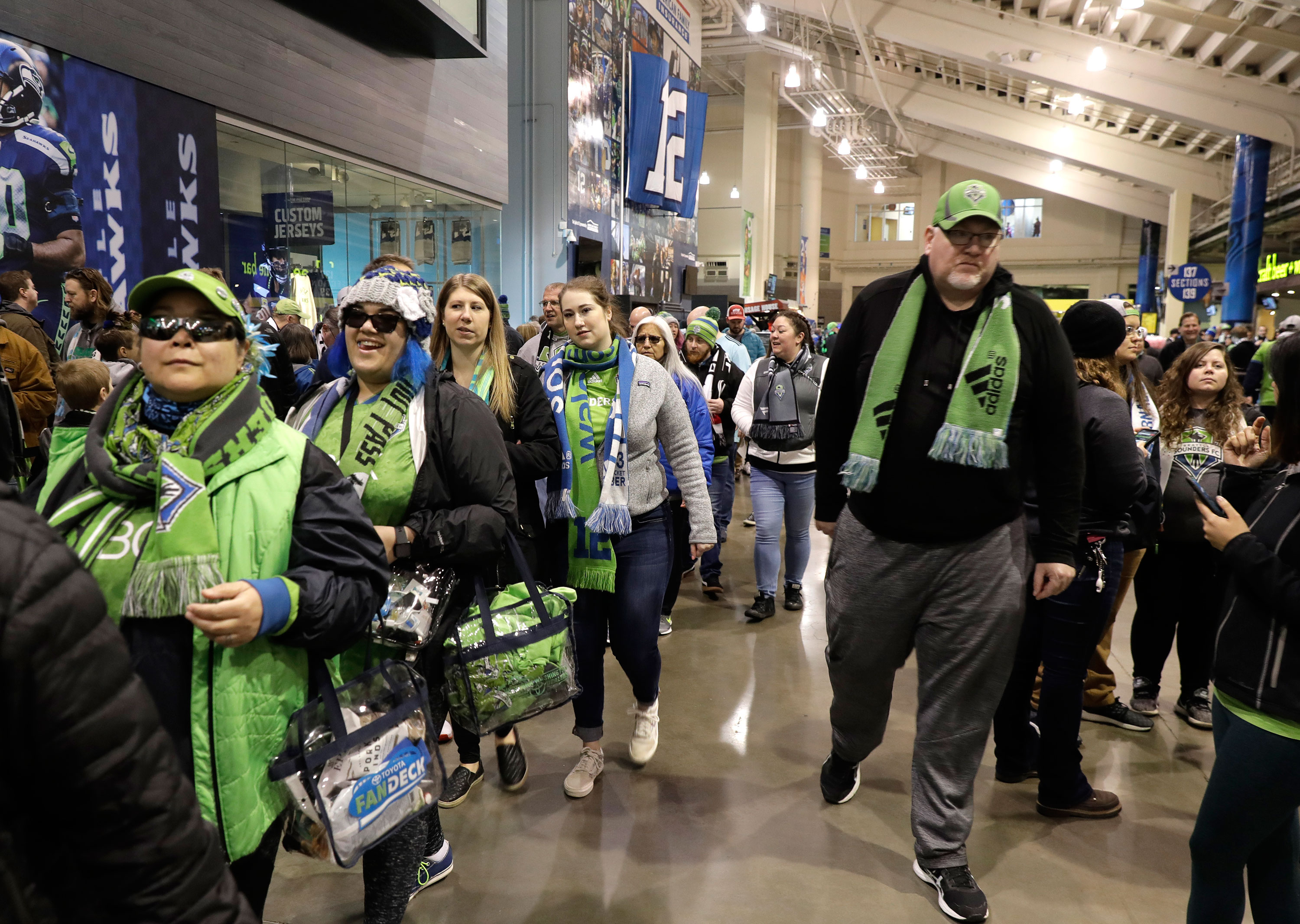 Fans attend an MLS match between the Seattle Sounders and Chicago Fire on March 1 in Seattle.