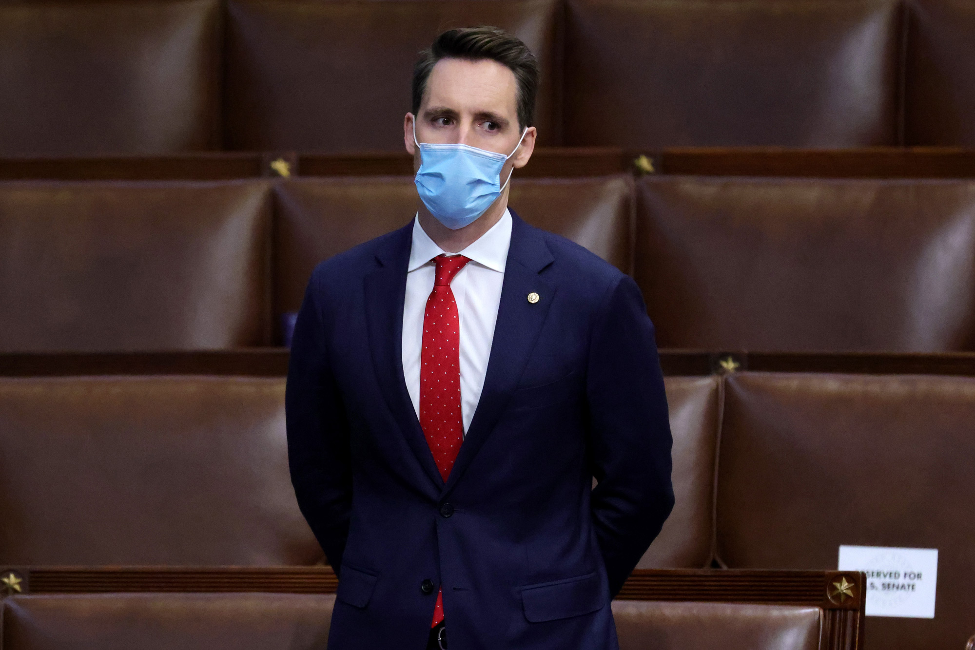 Sen. Josh Hawley stands in the House Chamber during a reconvening of a joint session of Congress on January 6 in Washington, DC.