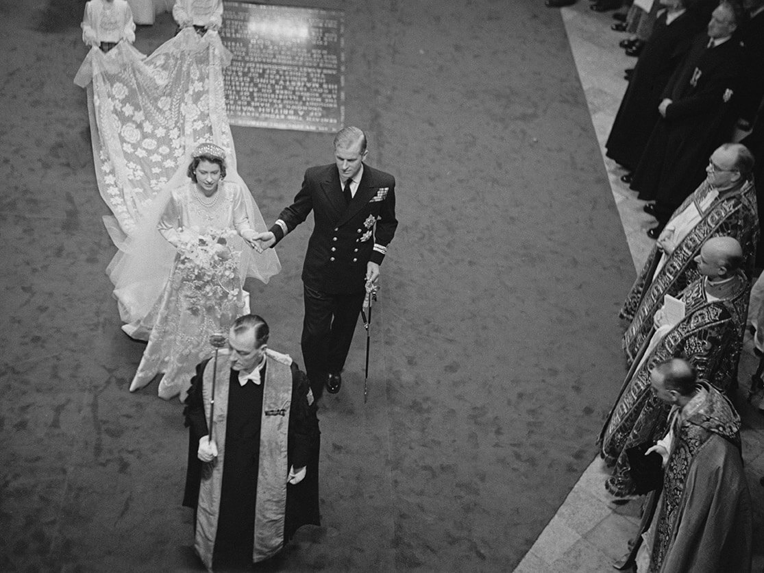 Elizabeth and Philip make their way down the aisle of Westminster Abbey on their wedding day, November 20, 1947.