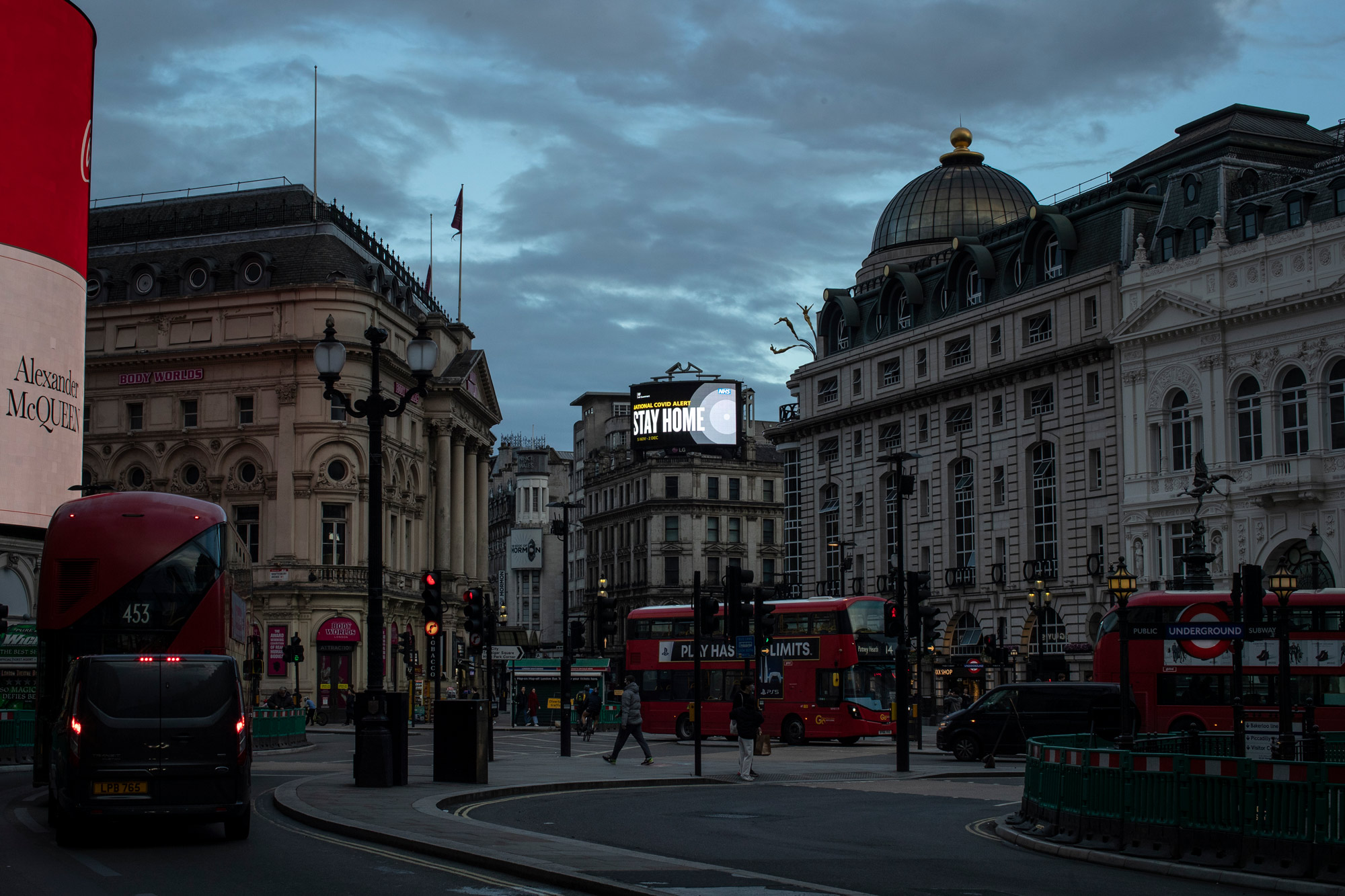 A public service notice encouraging people to stay home is displayed over Picadilly Circus on November 9 in London.