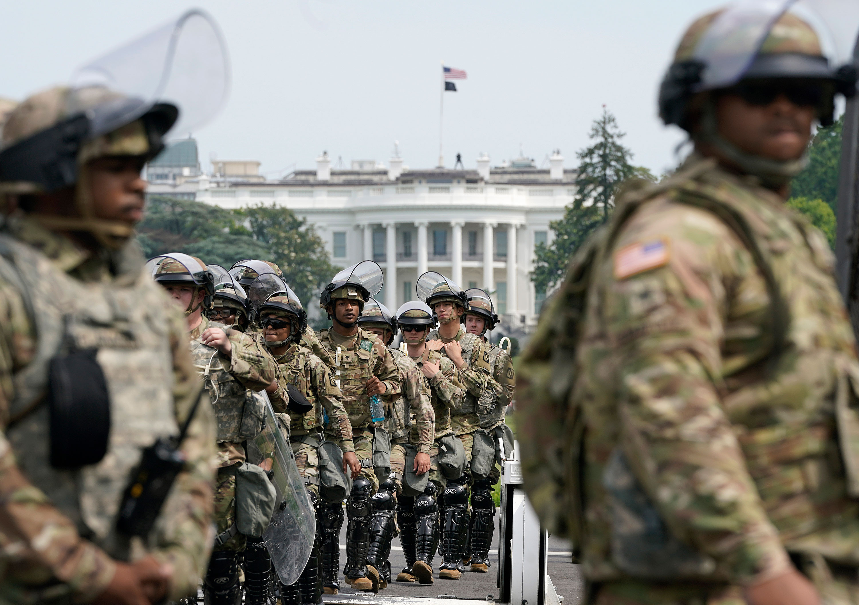 National Guard members deploy near the White House during protests on June 6, in Washington.
