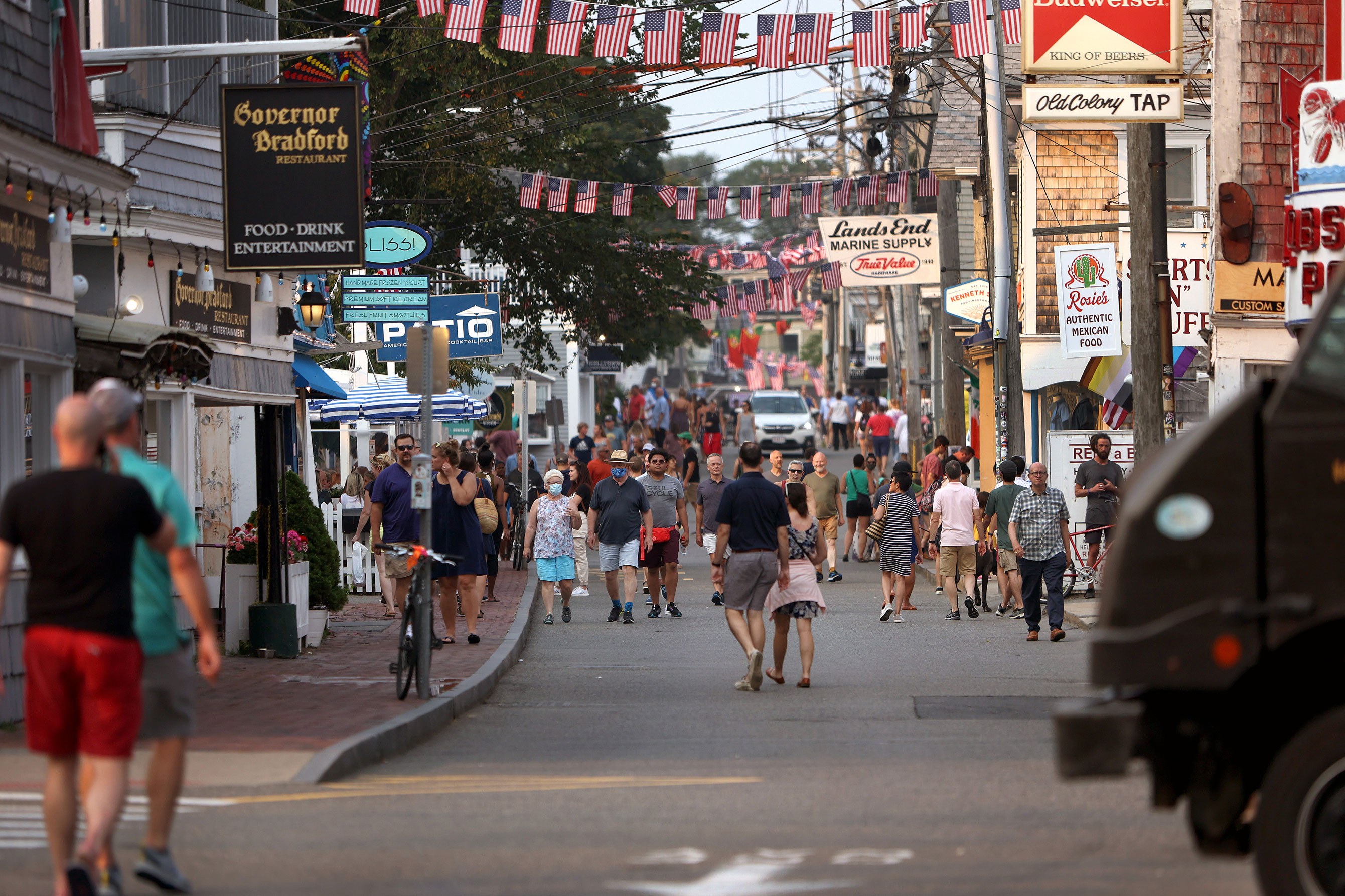 Foot traffic along Commercial street in Provincetown, Massachusetts on Tuesday, July 20.