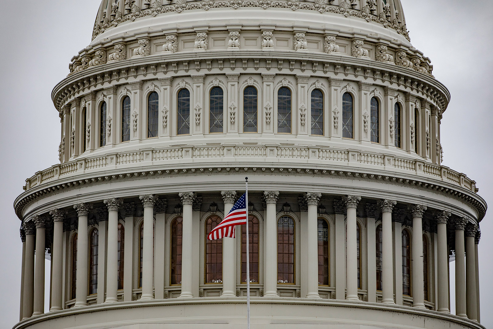 An American flag flies in front of the Capitol building in Washington, DC.