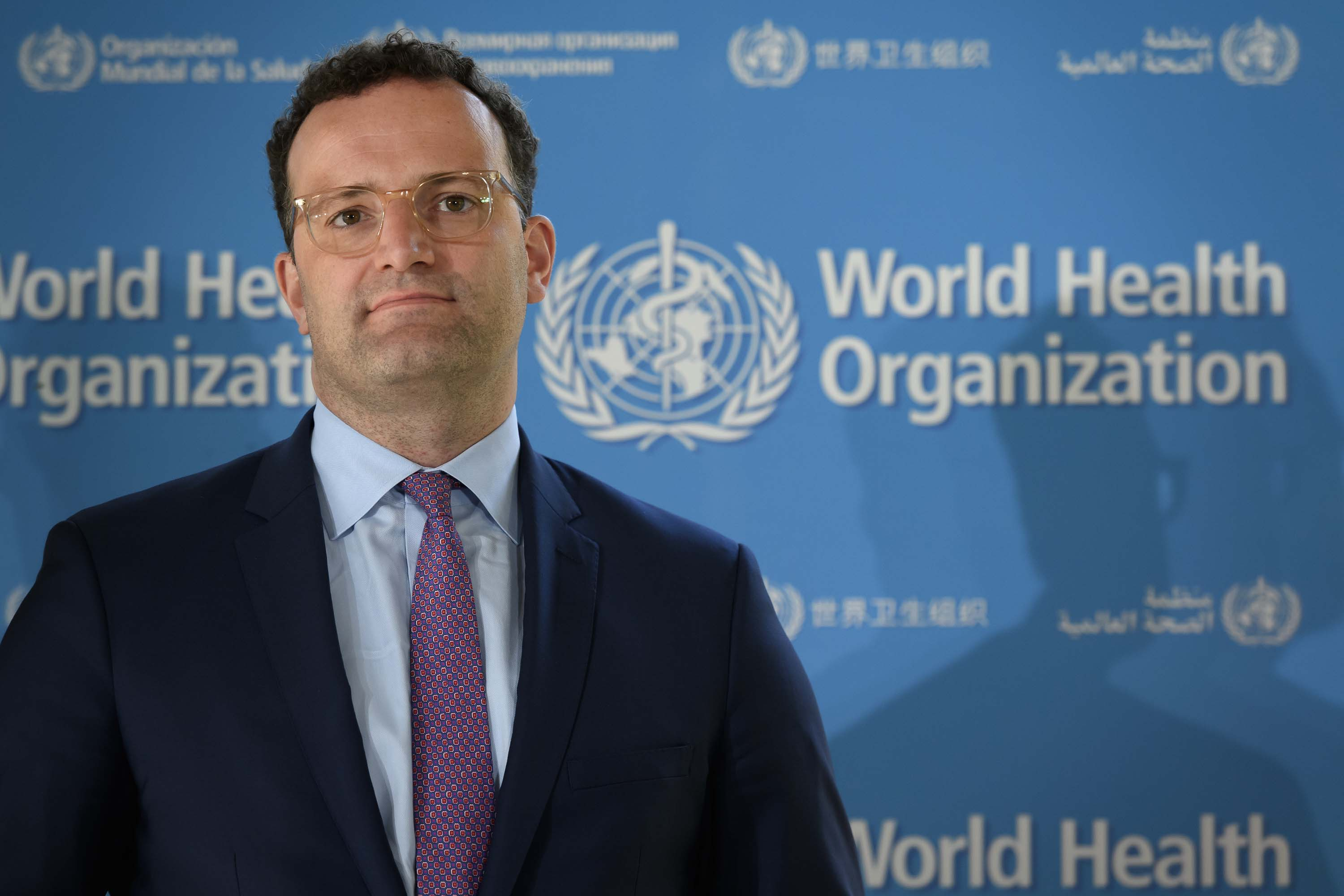 German Health Minister Jens Spahn looks on during a press conference at the World Health Organization headquarters in Geneva, Switzerland, on June 25, following a meeting about the COVID-19 outbreak.
