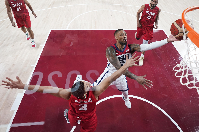 Damian Lillard of Team USA shoots over Iran's Mohammadsina Vahedi during a men's basketball preliminary round game in Saitama, Japan, on Wednesday, July 28.