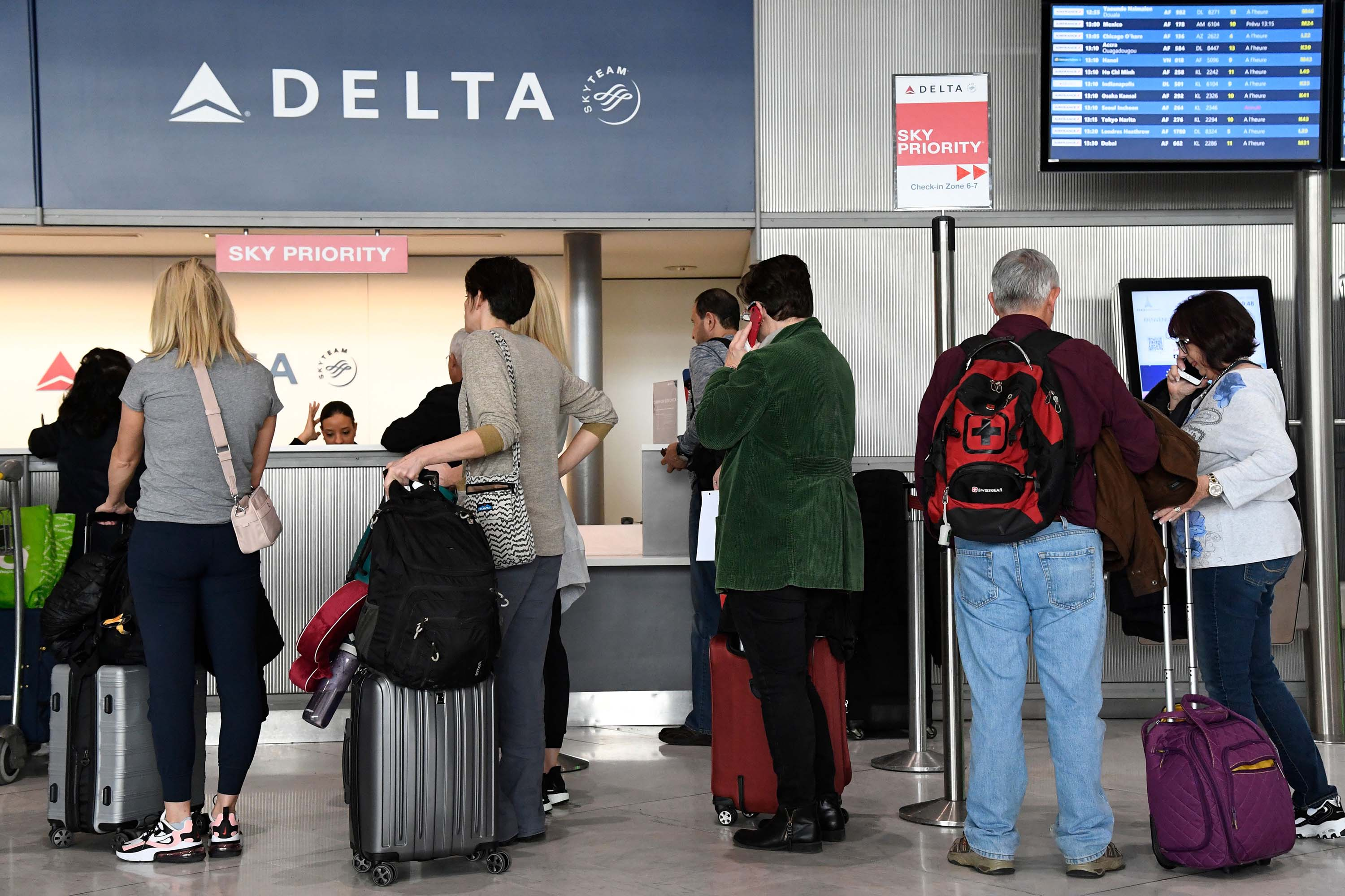 Passengers line up at a Delta Airlines desk at Paris-Charles-de-Gaulle airport in France on Thursday.
