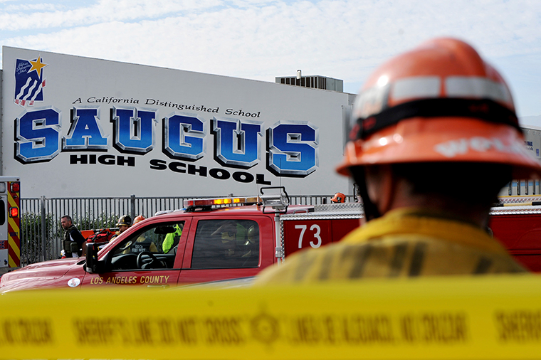 First responders standby for any injured students after a gunman opened fire at Saugus High School.