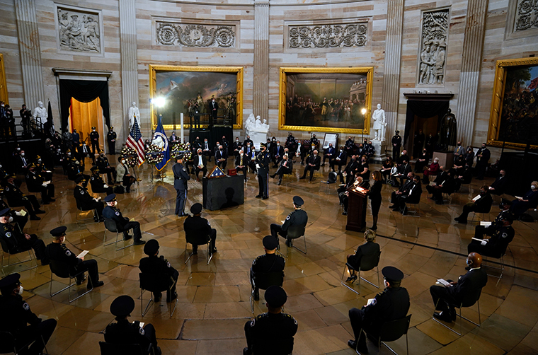 House Speaker Nancy Pelosi speaks during a ceremony memorializing U.S. Capitol Police officer Brian Sicknick, as an urn with his cremated remains lies in honor on a black-draped table at the center of the Capitol Rotunda, Wednesday, Feb. 3, 2021, in Washington.