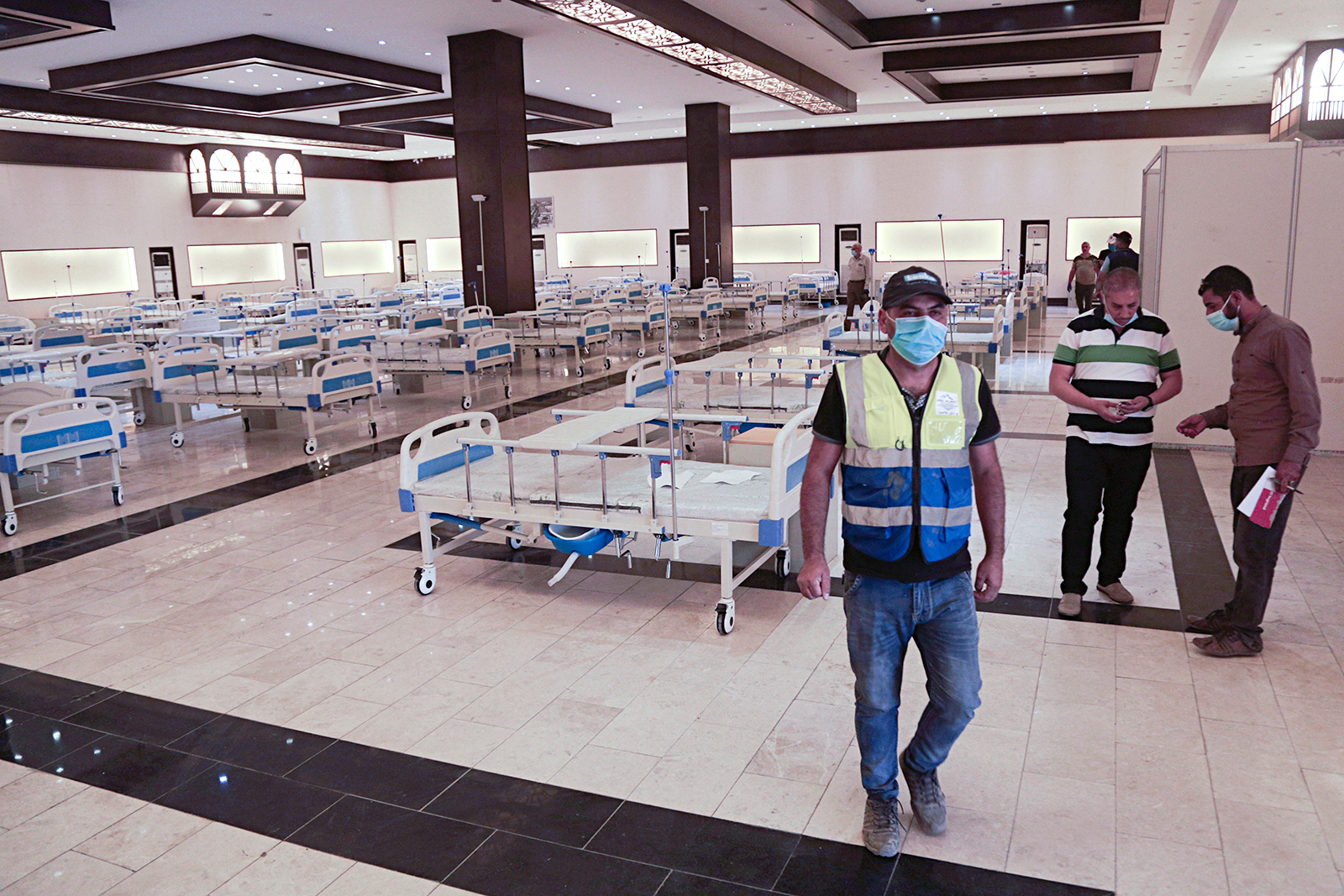 Workers set up a field hospital to treat patients with Covid-19 in Baghdad, Iraq on June 20.