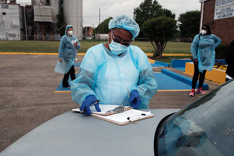 Medical workers with Delta Health Center prepare to vaccinate people at a pop-up COVID-19 vaccination clinic in a rural Delta community on April 29, 2021 in Leland, Mississippi.