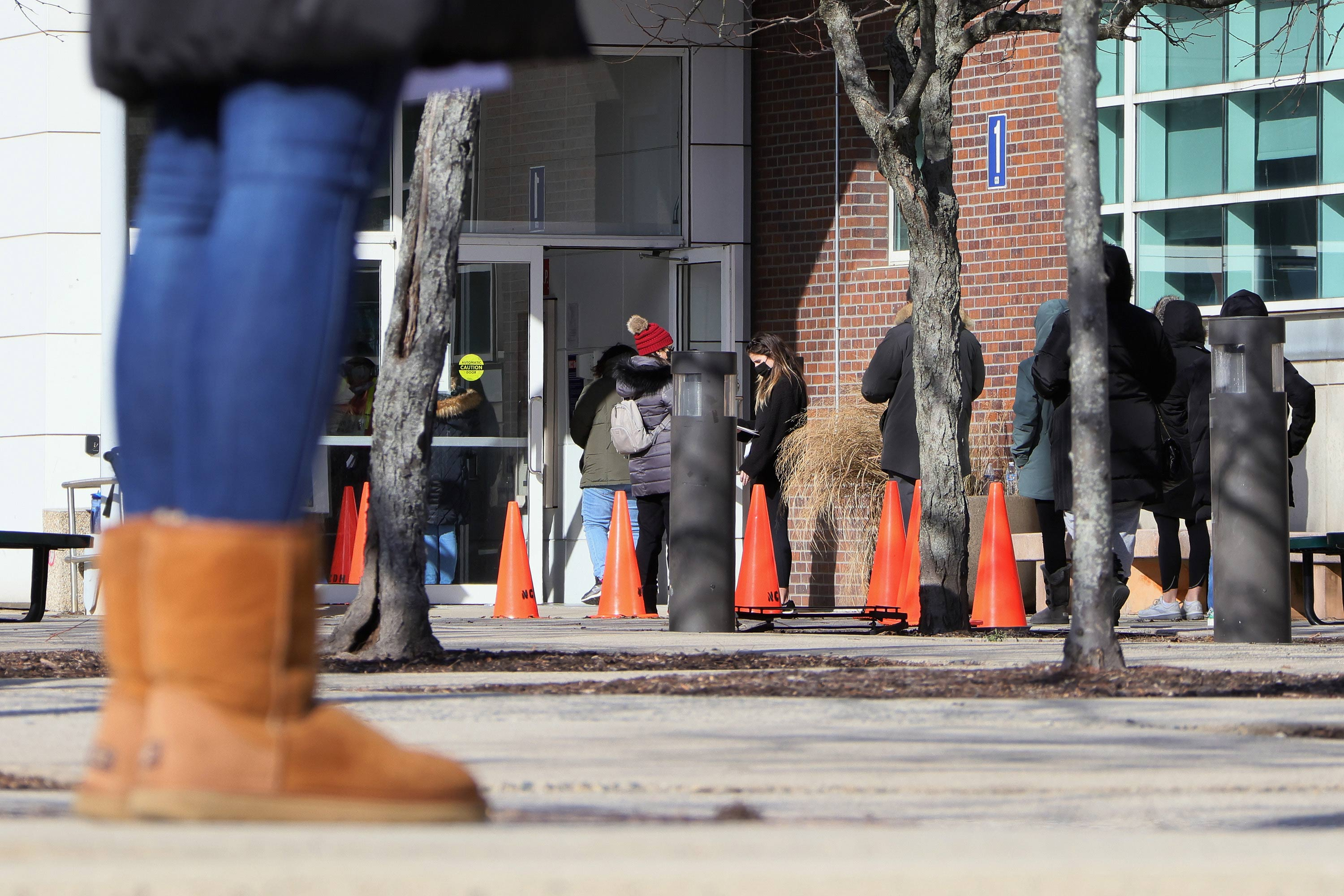 People line up for COVID-19 vaccinations at Nassau Community College on January 10 in Garden City, New York.