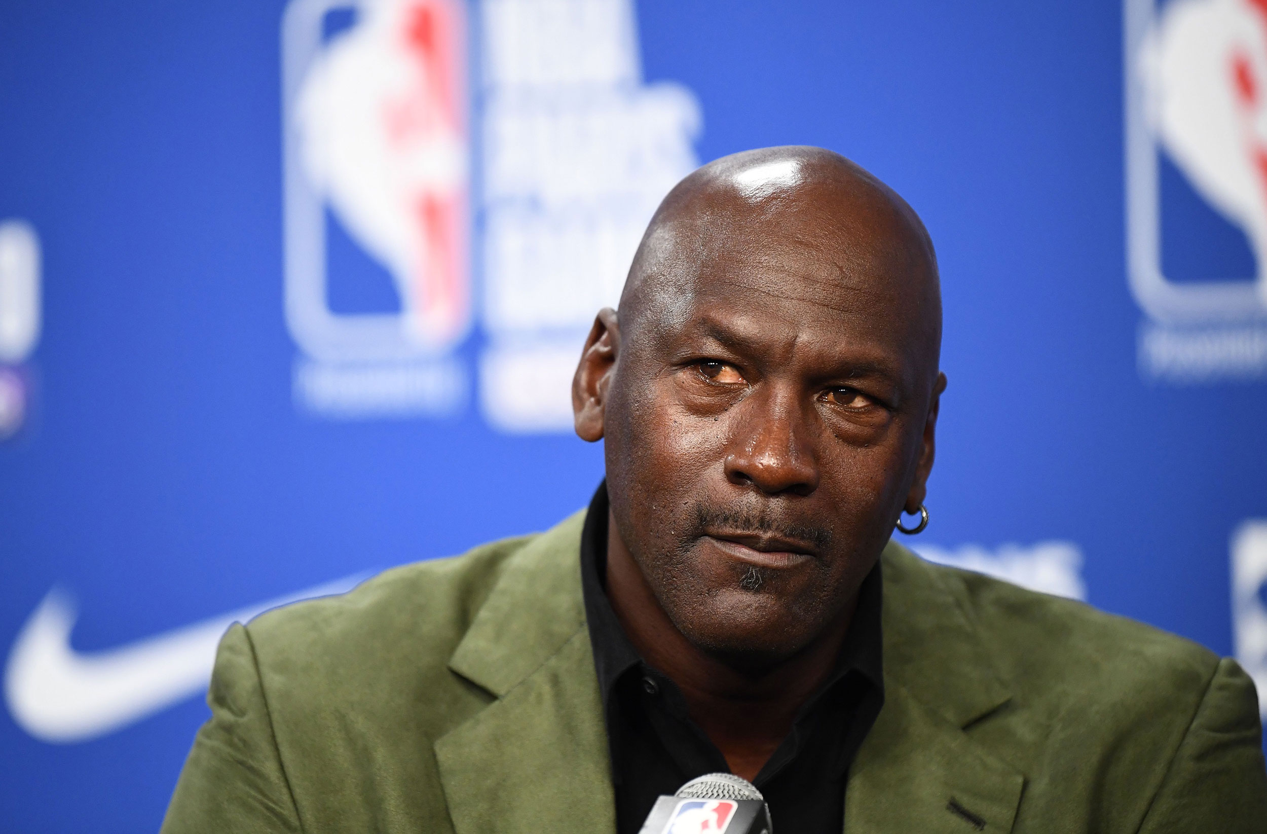 Michael Jordan speaks at a press conference before an NBA game on January 24.