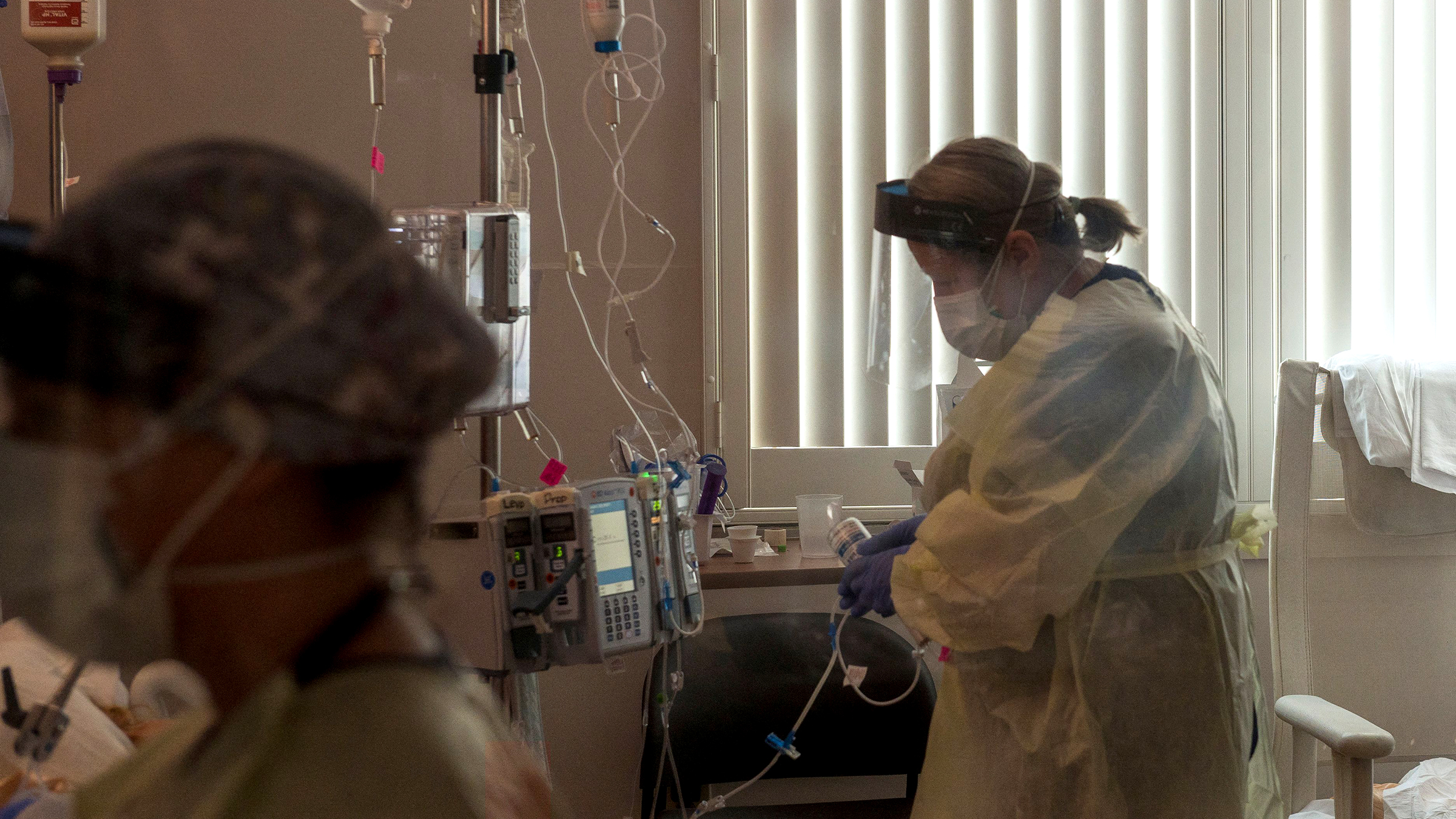 A registered nurse tends to a Covid-19 patient inside the intensive care unit at Adventist Health in Sonora, California, on August 27.