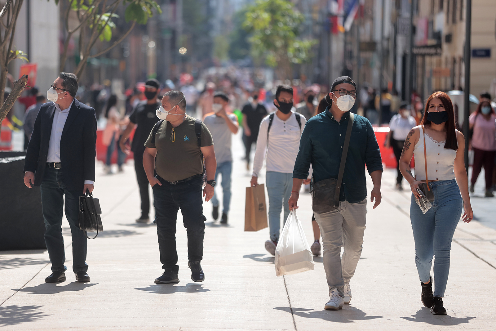 Streets in downtown Mexico City are full of people using face masks on July 13.