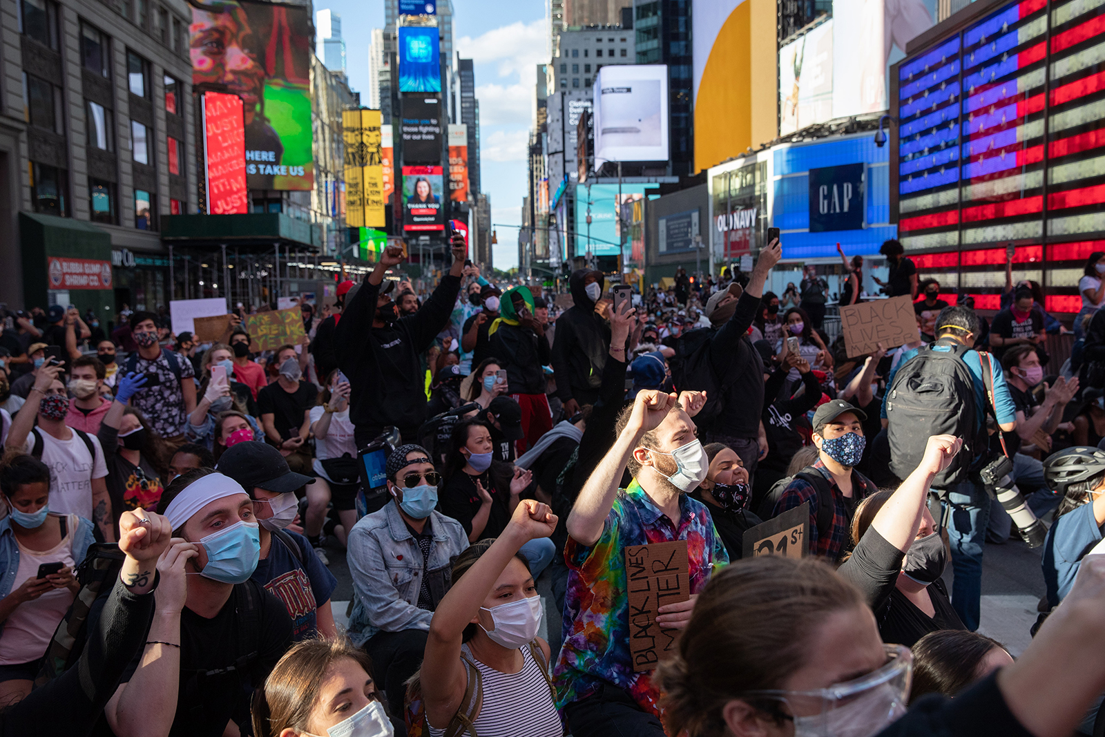 Black Lives Matter protesters kneel in Times Square while marching to honor George Floyd in New York, on May 31.